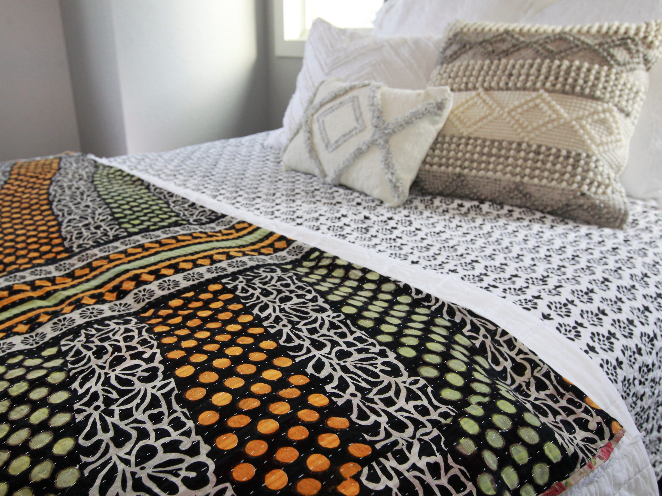 Laura Goranson selected comfy and cozy textured bedding for the canopy bed in a guest bedroom.