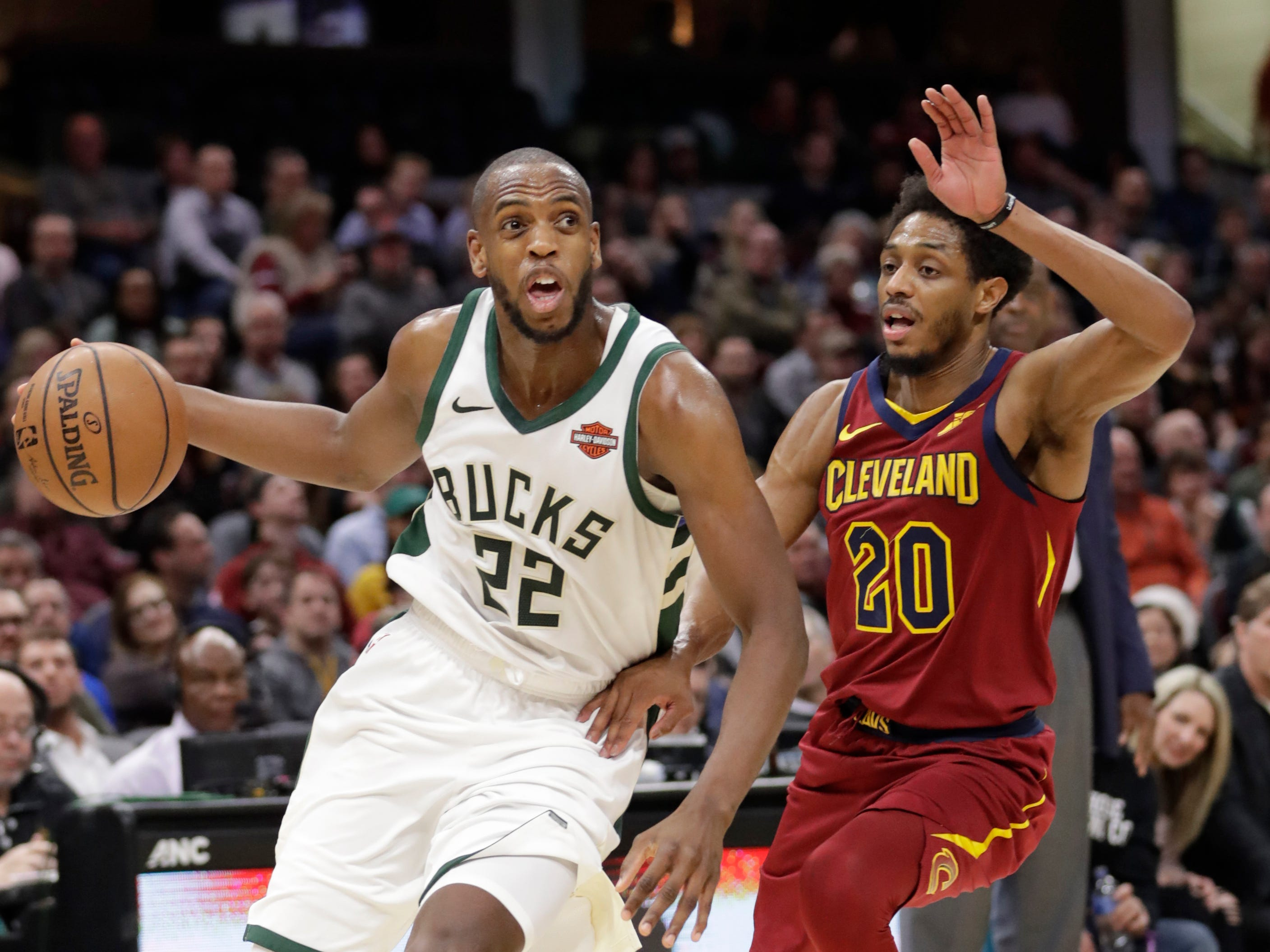 Bucks forward Khris Middleton easily drives past Brandon Knight of the Cavaliers in the first half.