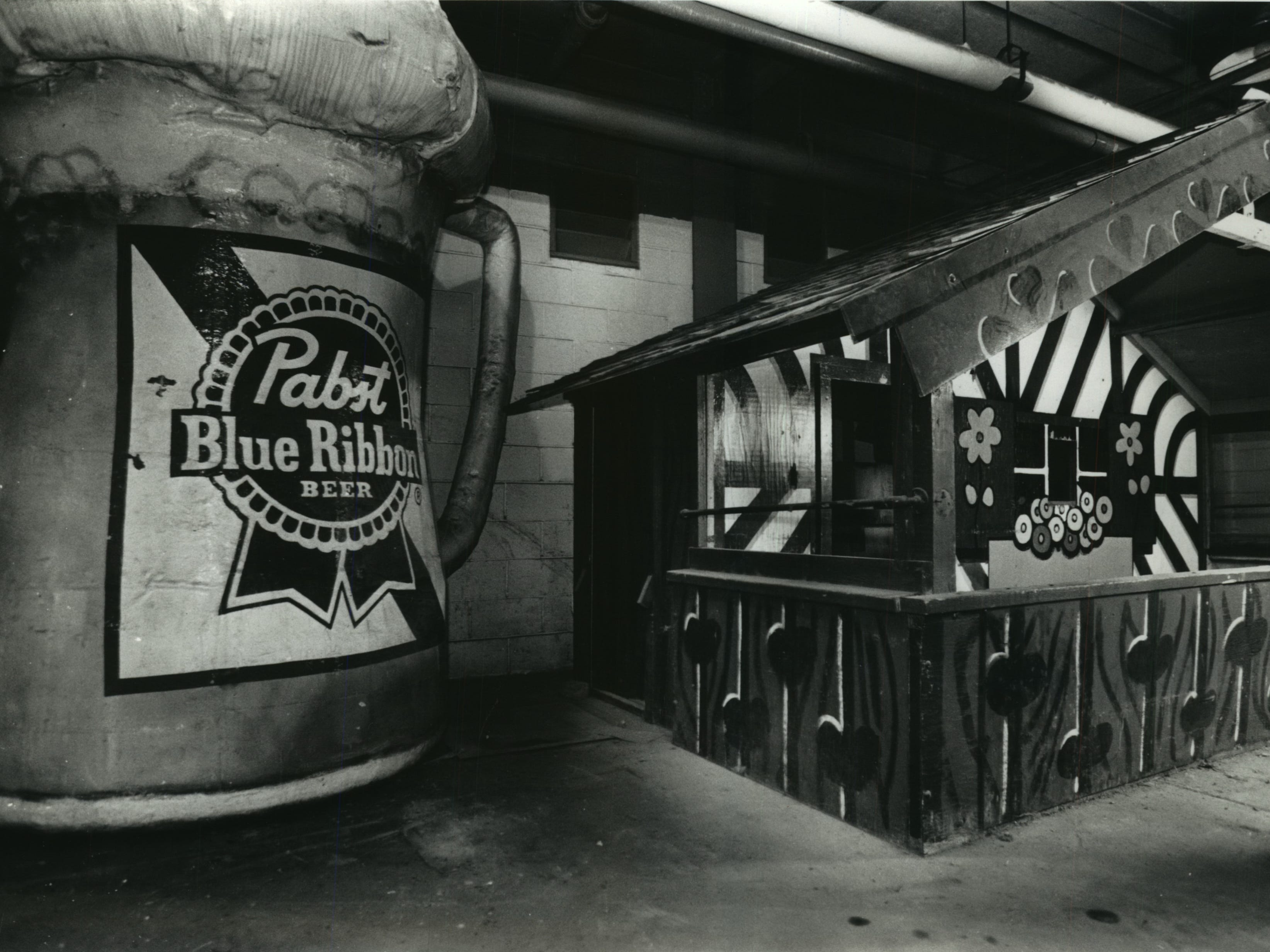 Bernie Brewer's old center field home was stored, still intact, in the recesses of County Stadium after it was removed from the center-field bleachers after the 1984 season. This photo was published in the July 8, 1992, Milwaukee Journal, when the Milwaukee Brewers began talking about bringing the mug and chalet back.