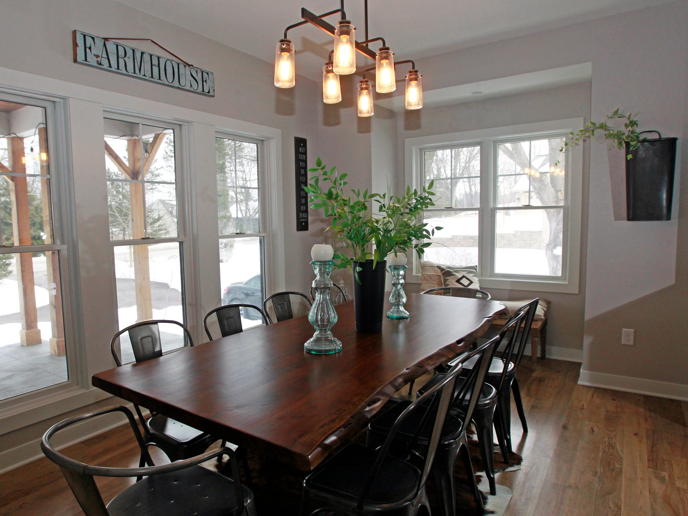 Vintage Depression candlesticks sit on the large live-edge walnut dining room table.