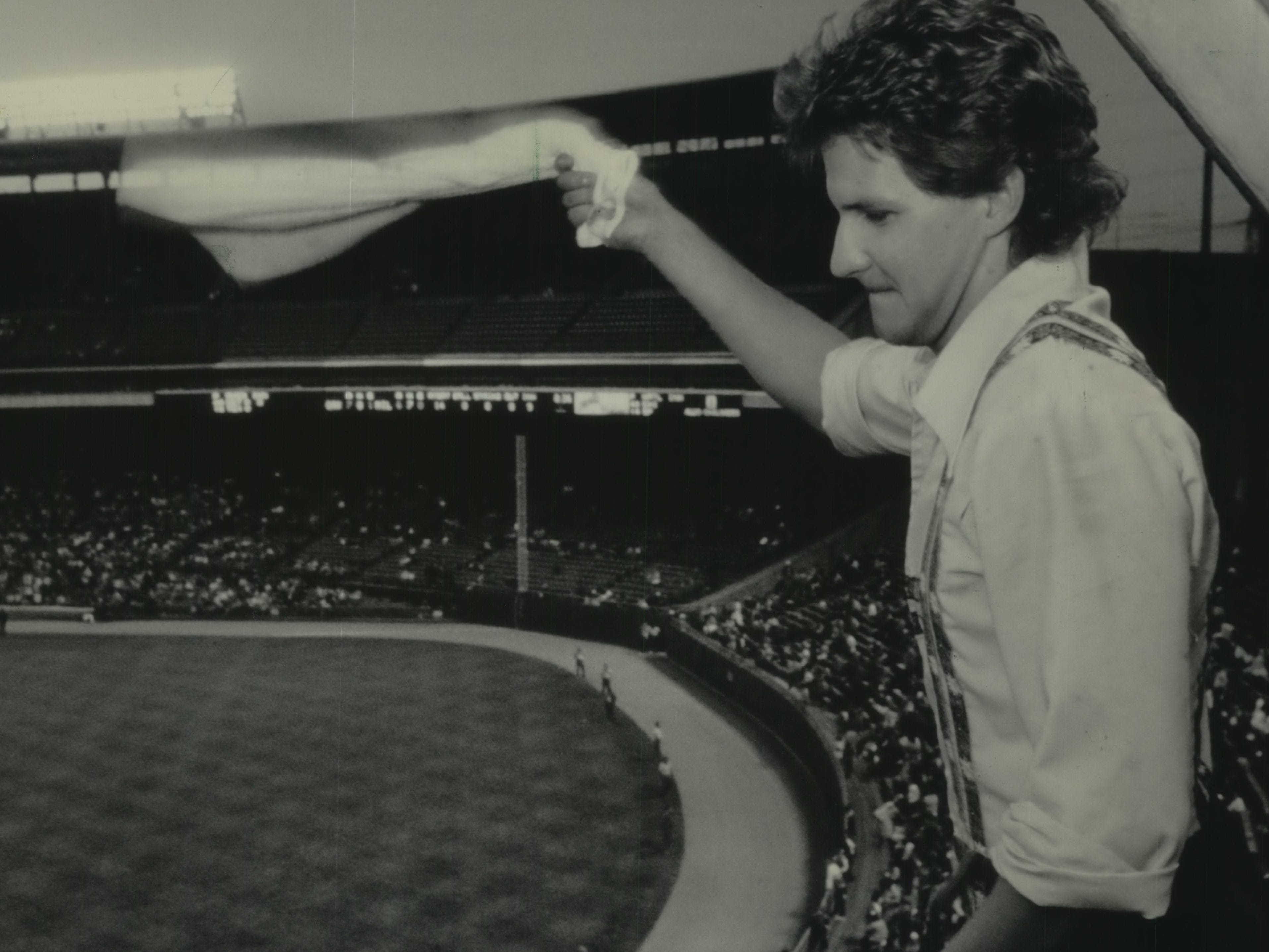 Bernie Brewer (real name: Tom Lund) tries to stir up the crowd from his chalet above the bleachers in center field, using his version of the rally towel during a game on July 6, 1984, during a doubleheader at County Stadium. This photo was published in the July 9, 1984, Milwaukee Journal.