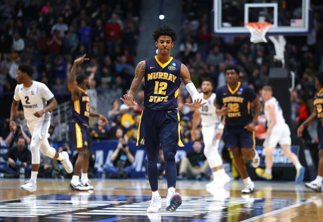 Murray State guard Ja Morant celebrates a basket in the Racers' blowout victory over Marquette on Thursday. Morant had 17 points, 16 assists and 11 rebounds.