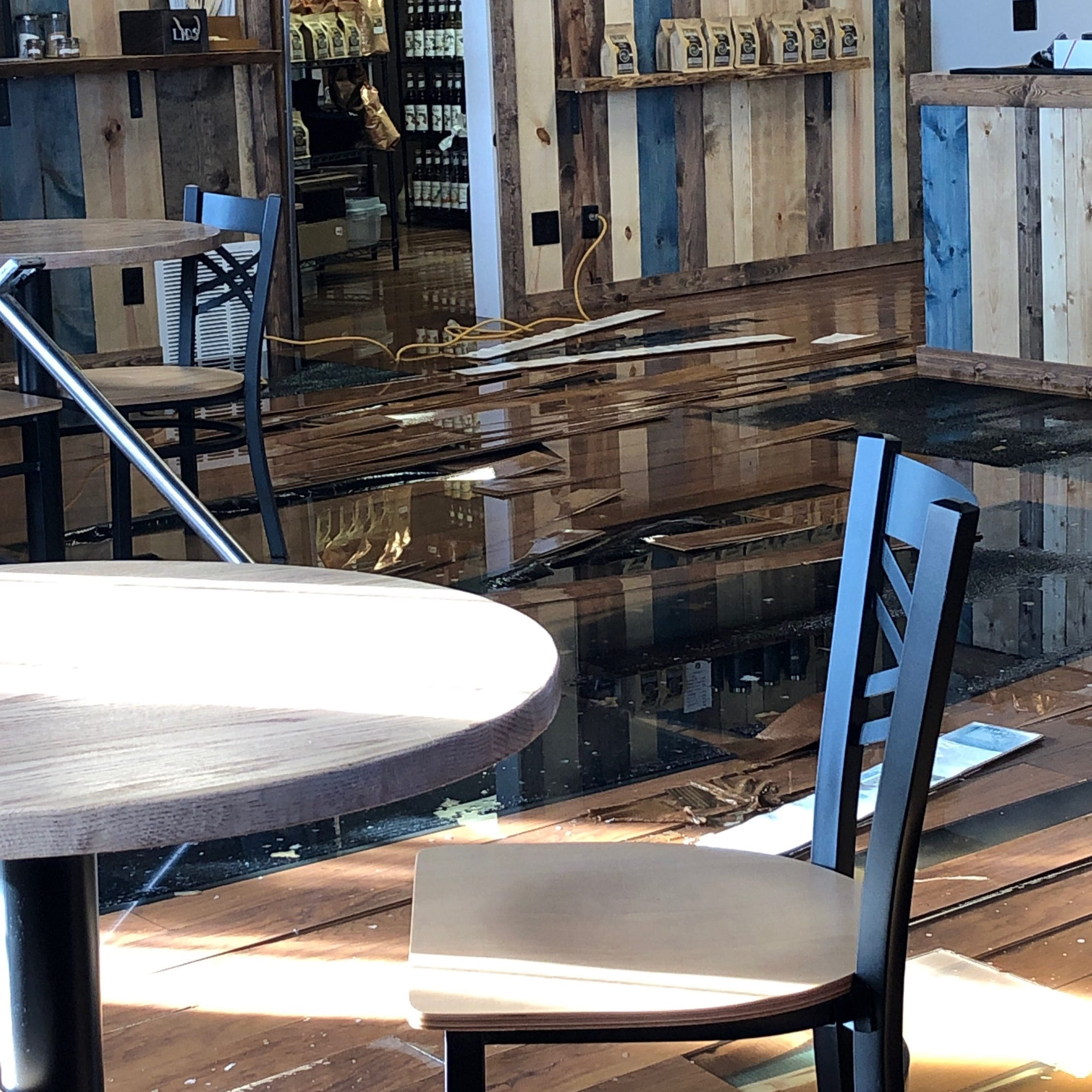 This coffee shop owner spent six months renovating his business. Three months later, half of it was flooded.