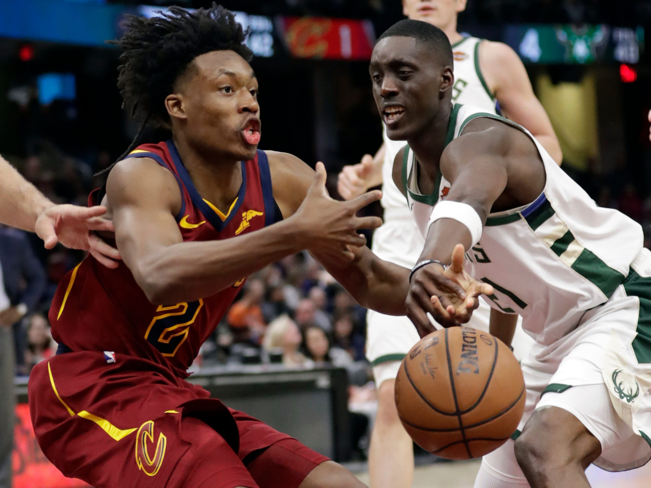 Bucks guard Tony Snell cleanly knocks the ball out of the hands of Cavaliers guard Collin Sexton during the second half.