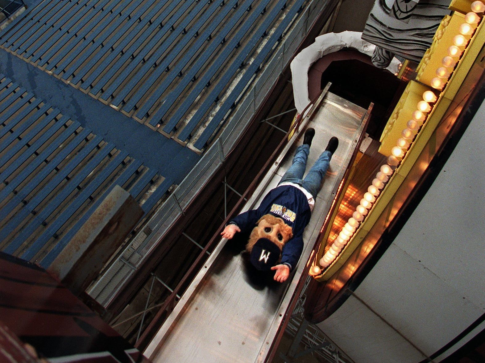 Bernie Brewer gets in some practice slides from his chalet into the giant beer mug in the bleachers at Milwaukee County Stadium on April 1, 1998. This photo was published in the April 2, 1998, Milwaukee Journal Sentinel.