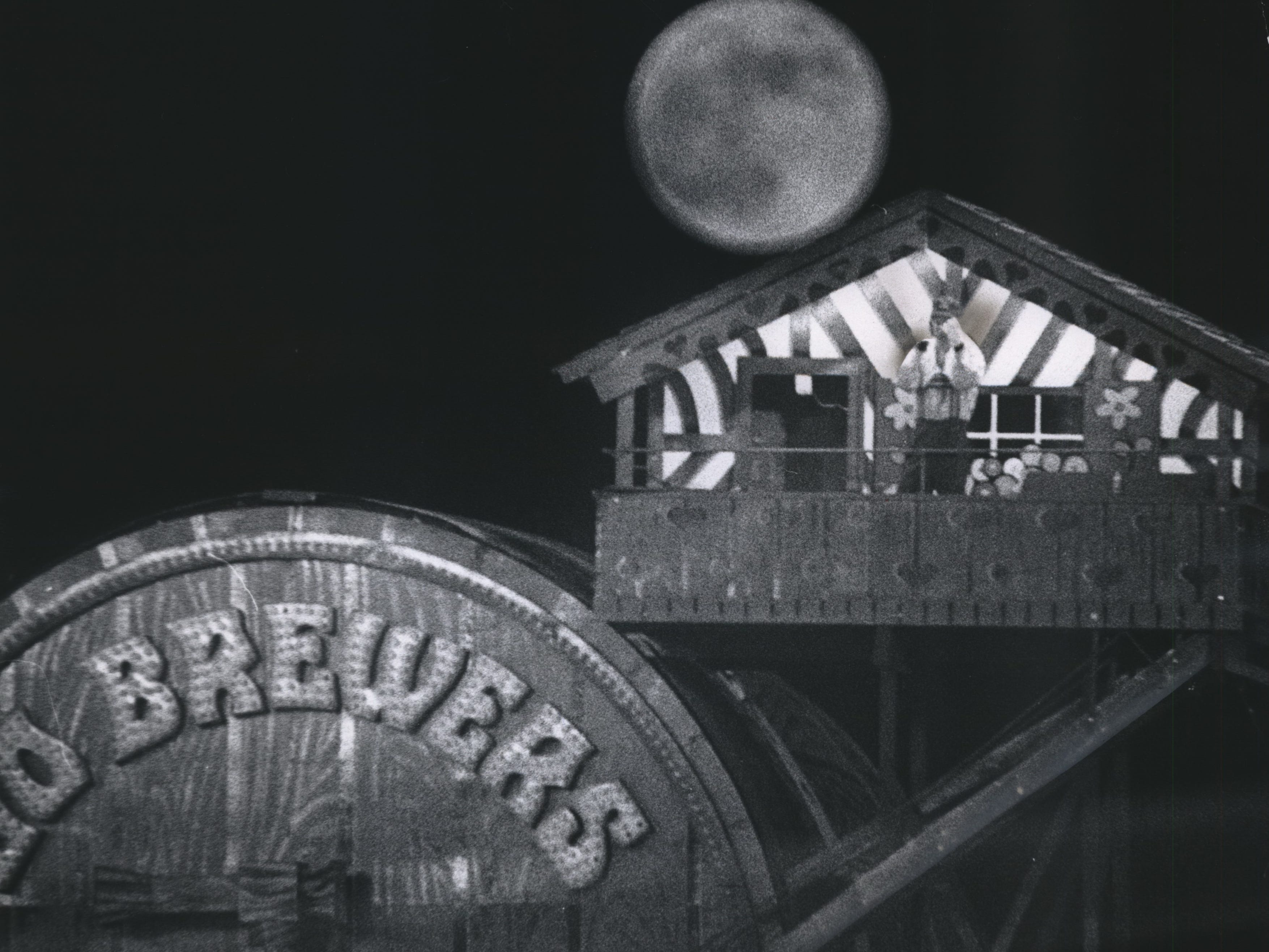 Bernie Brewer enjoys a night on the porch of his chalet above the bleachers (and below the moon) at County Stadium. Bernie's upstairs apartment stood above the ballpark through the 1974 season. This photo was published in the June 7, 1974, Milwaukee Journal.