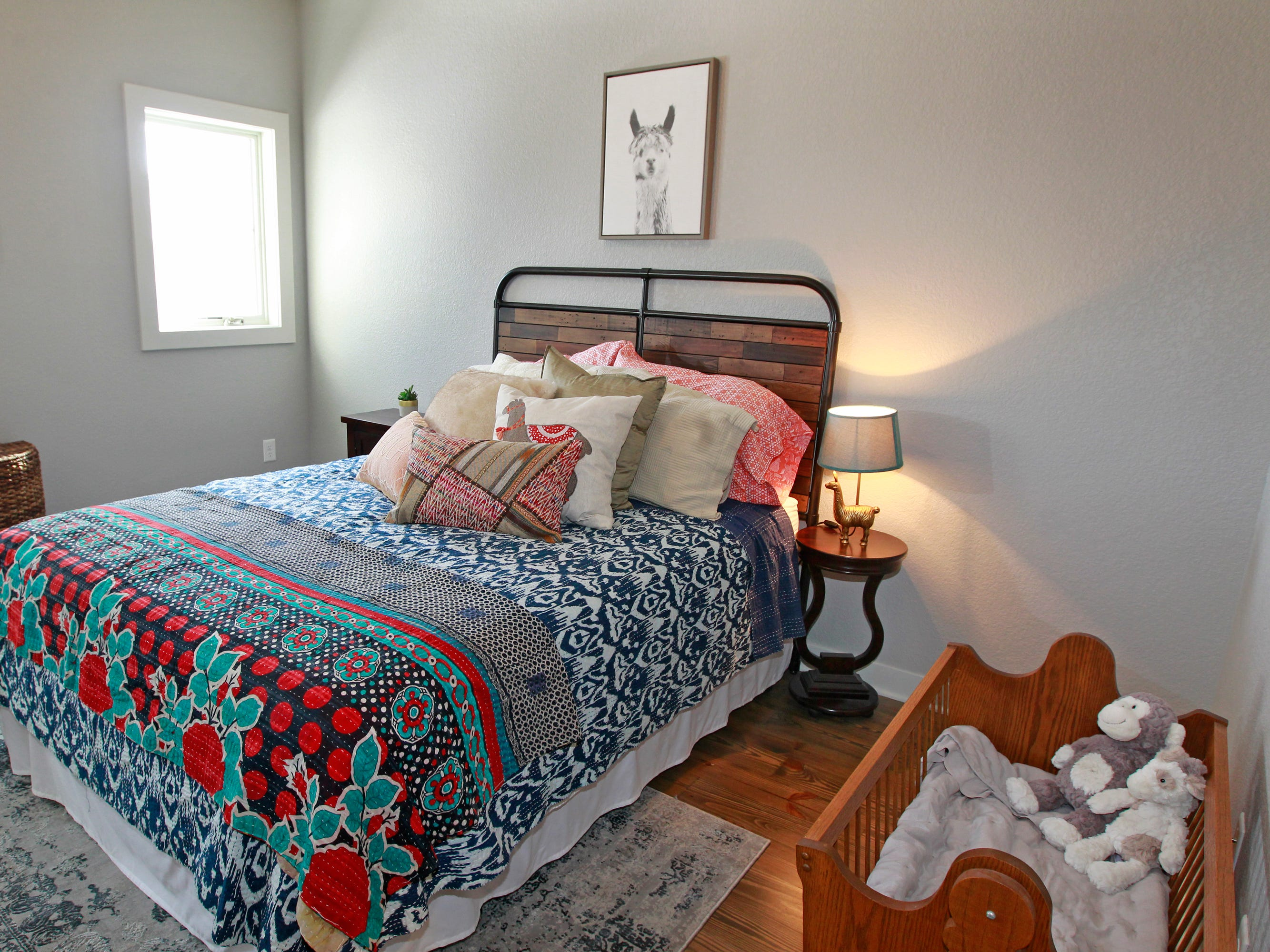 The grandkids' guest room includes a cradle that was made by Kurt Goranson's father. It was used by his children, grandchildren and other family members throughout the years.  A  Kantha quilt from India has bright fabrics that are pieced together.