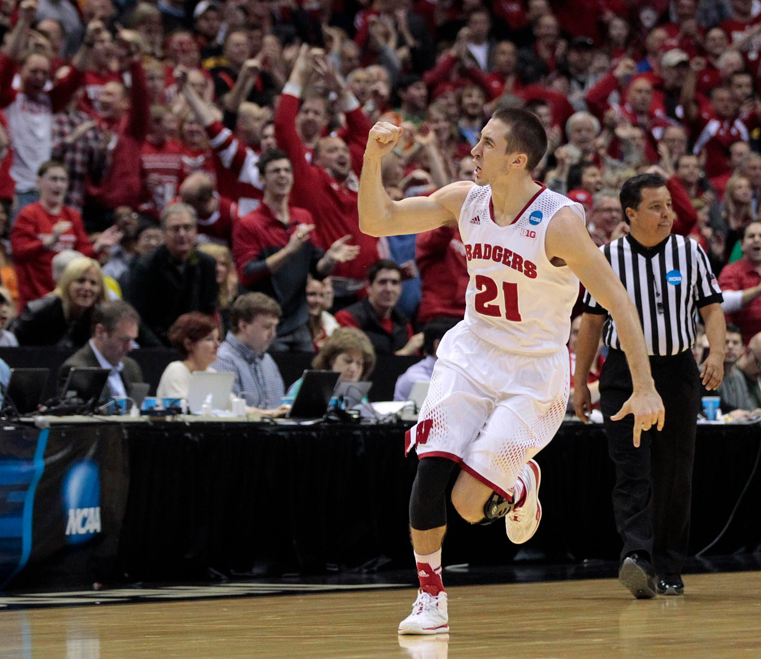Josh Gasser  celebrates a Wisconsin lead in the final minutes against Oregon in a 2014 NCAA Tournament game at the BMO Harris Bradley Center.