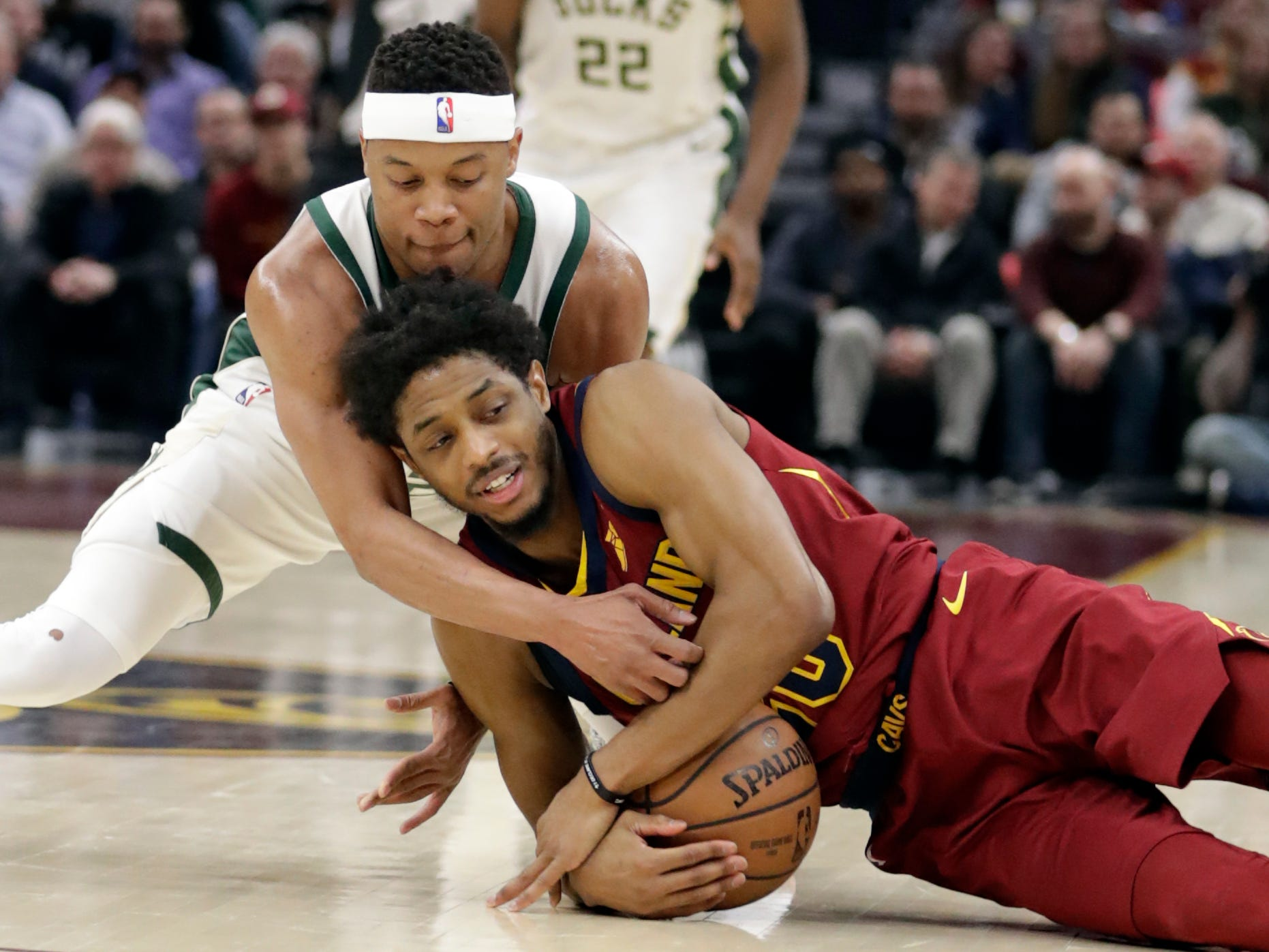 Recently acquired Bucks guard Tim Frazier tries to get a jump ball call with Brandon Knight, but instead the Cavaliers were called for a backcourt violation during the first half.