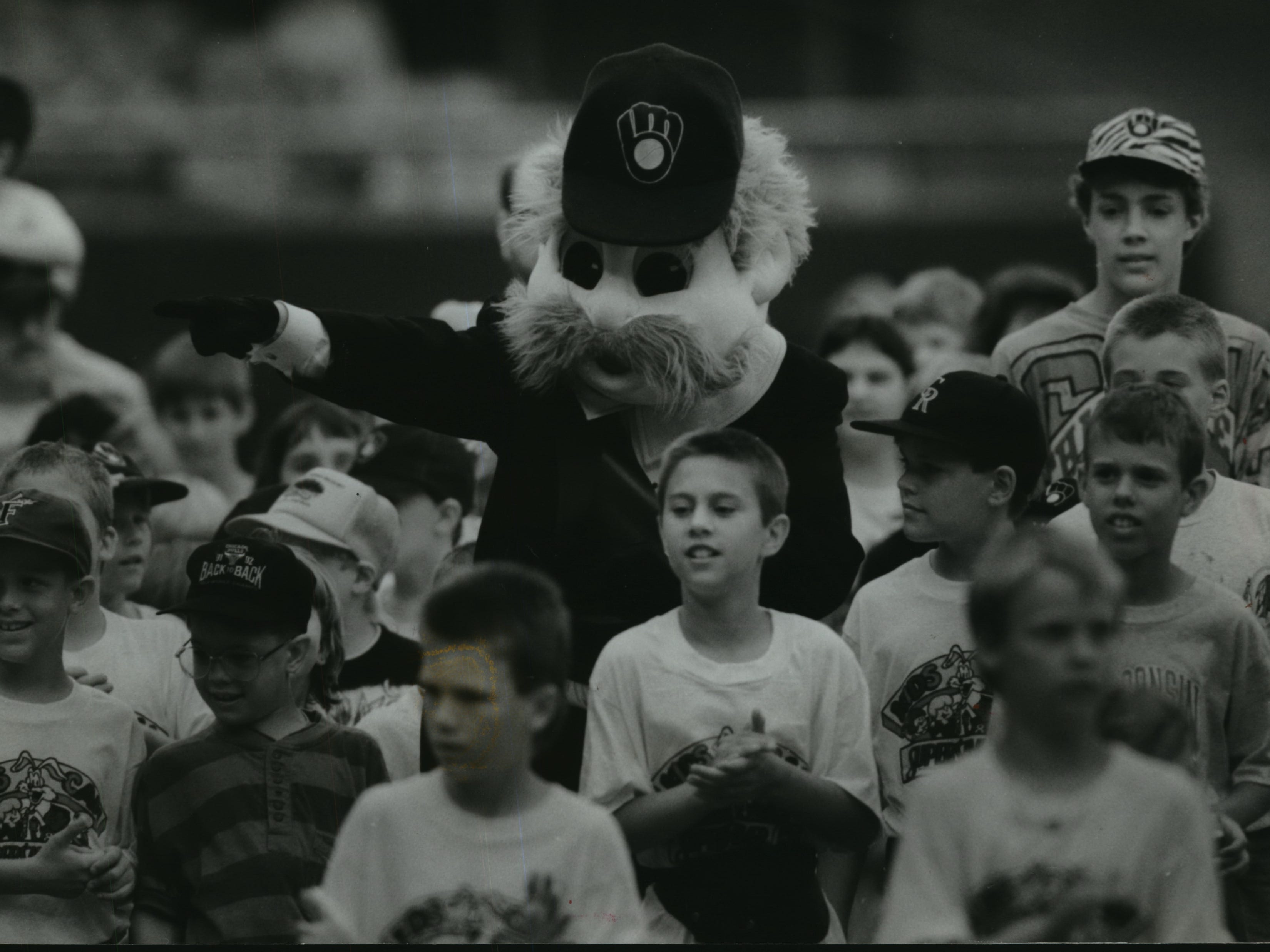 Kids lead Bernie Brewer in a procession into Milwaukee County Stadium on June 8, 1993. Bernie had been absent from the ballpark since 1984, when the Brewers removed his chalet from the center field bleachers.  This photo was published in the June 9, 1993, Milwaukee Sentinel.