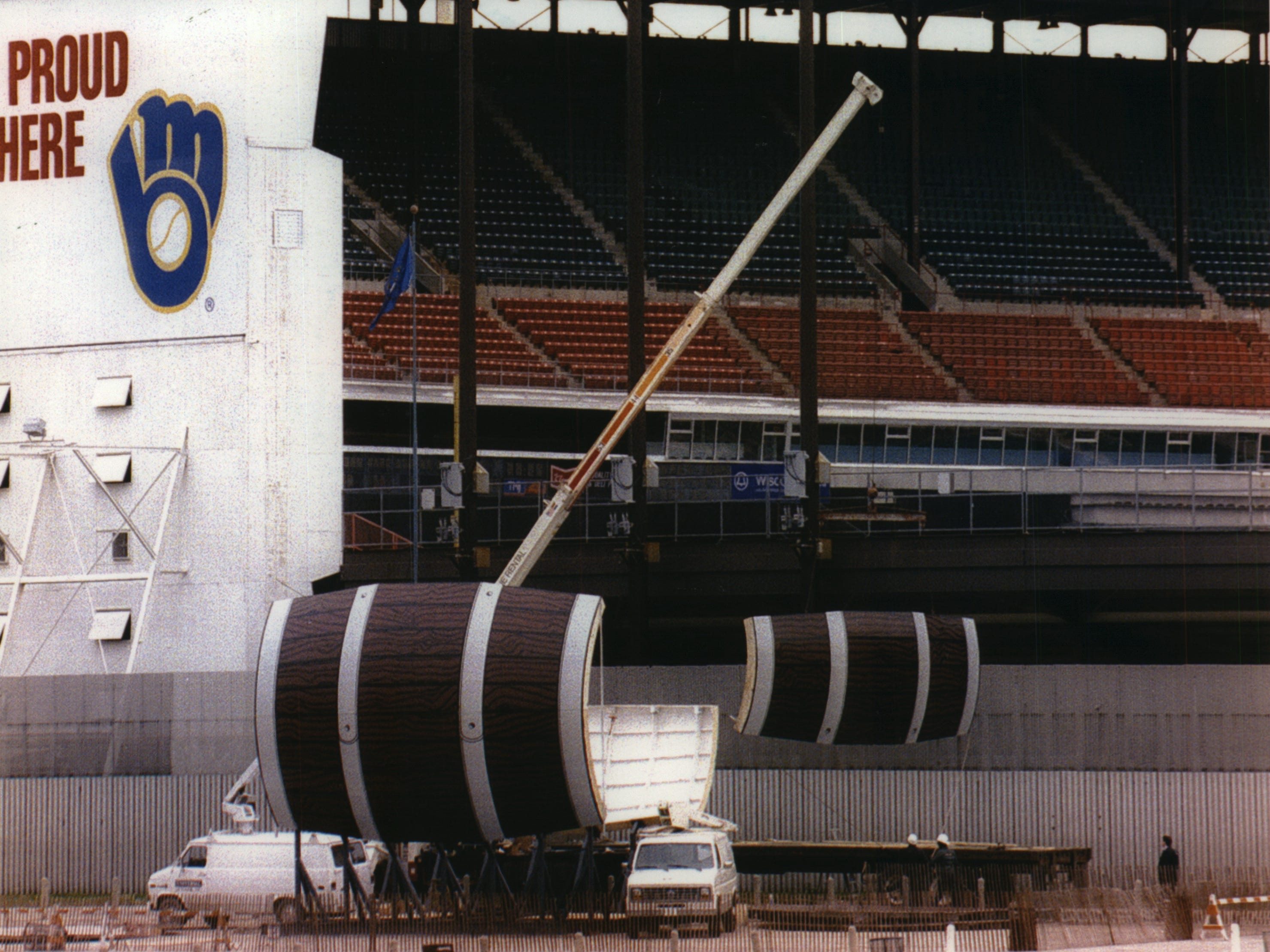 A Derse Inc. crane lifts a section of Bernie Brewer's new beer-barrel mug into place at County Stadium on May 17, 1993. This photo was published in the May 18, 1993, Milwaukee Sentinel.