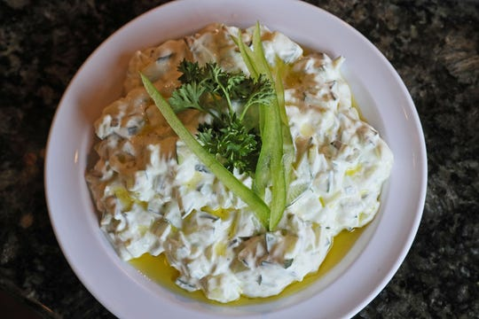 Pita Palace's cucumber salad in thick, creamy yogurt.