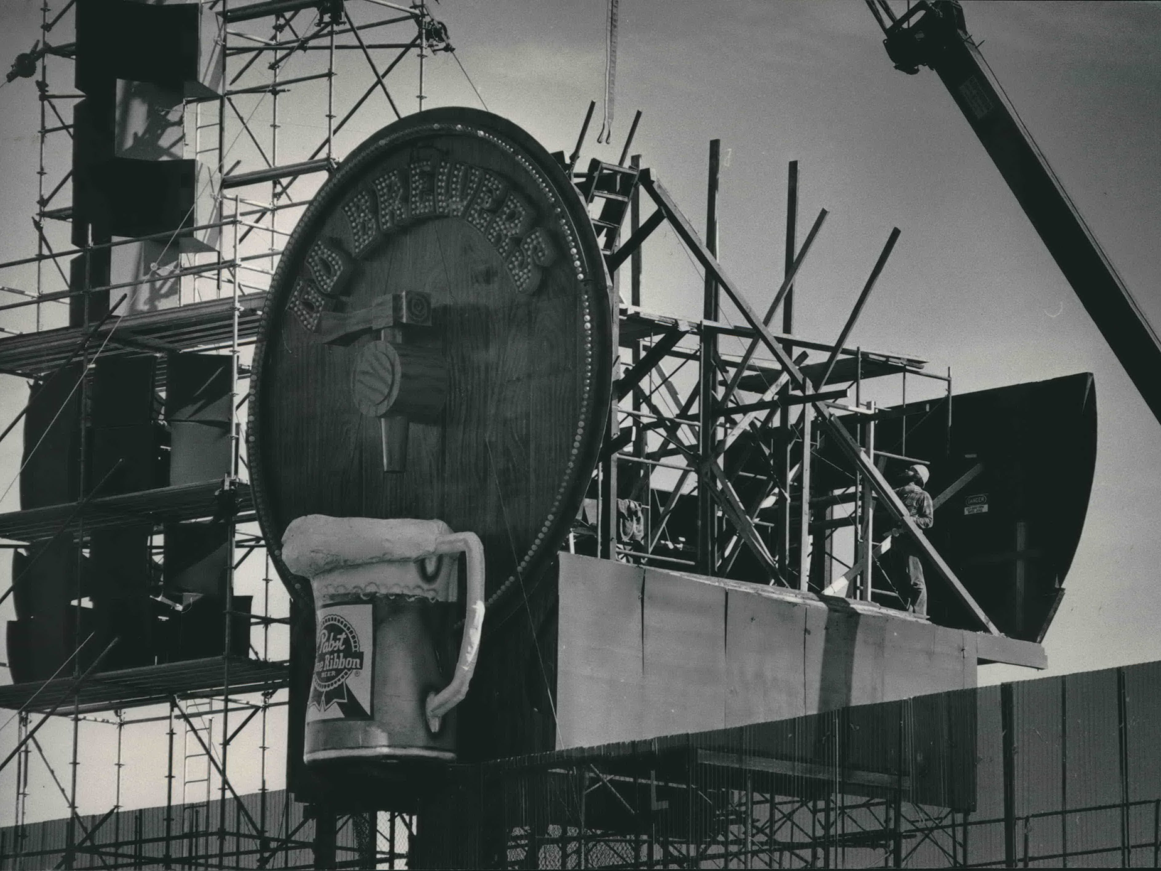 Workers dismantle Bernie Brewer's chalet, beer keg and mug on Oct. 17, 1984, to clear the way for a new sound system and additional bleachers at County Stadium. This photo was published in the Oct. 18, 1984, Milwaukee Sentinel.