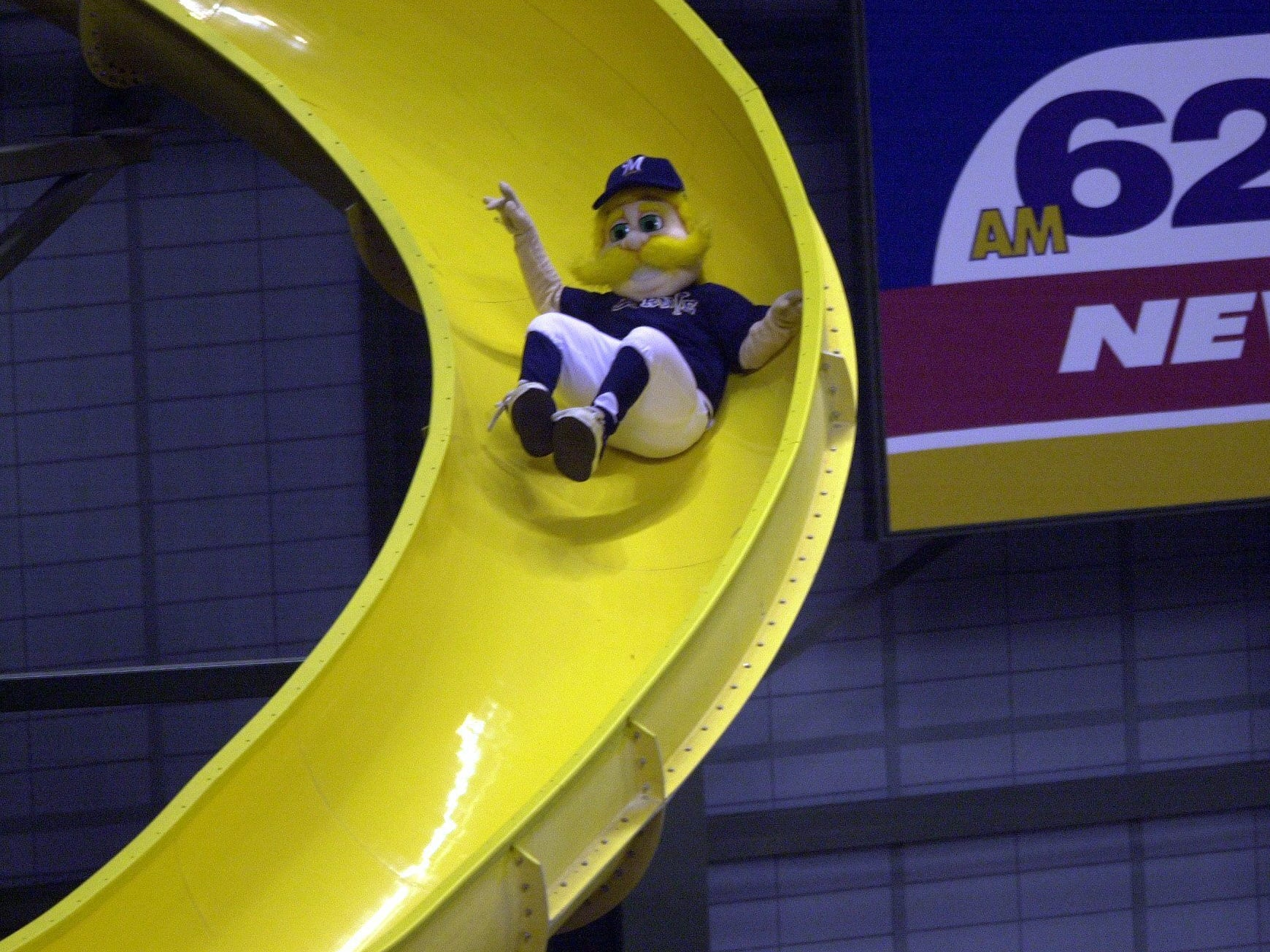 """Bernie Brewer takes his first slide during an official game on April 6, 2001, at the inaugural opening day at Miller Park. Instead of a chalet with a simple slide to a mug of beer, Bernie in Miller Park has his own """"dugout,"""" with a corkscrew slide leading to a platform. This photo was published in the April 7, 2001, Milwaukee Journal Sentinel."""
