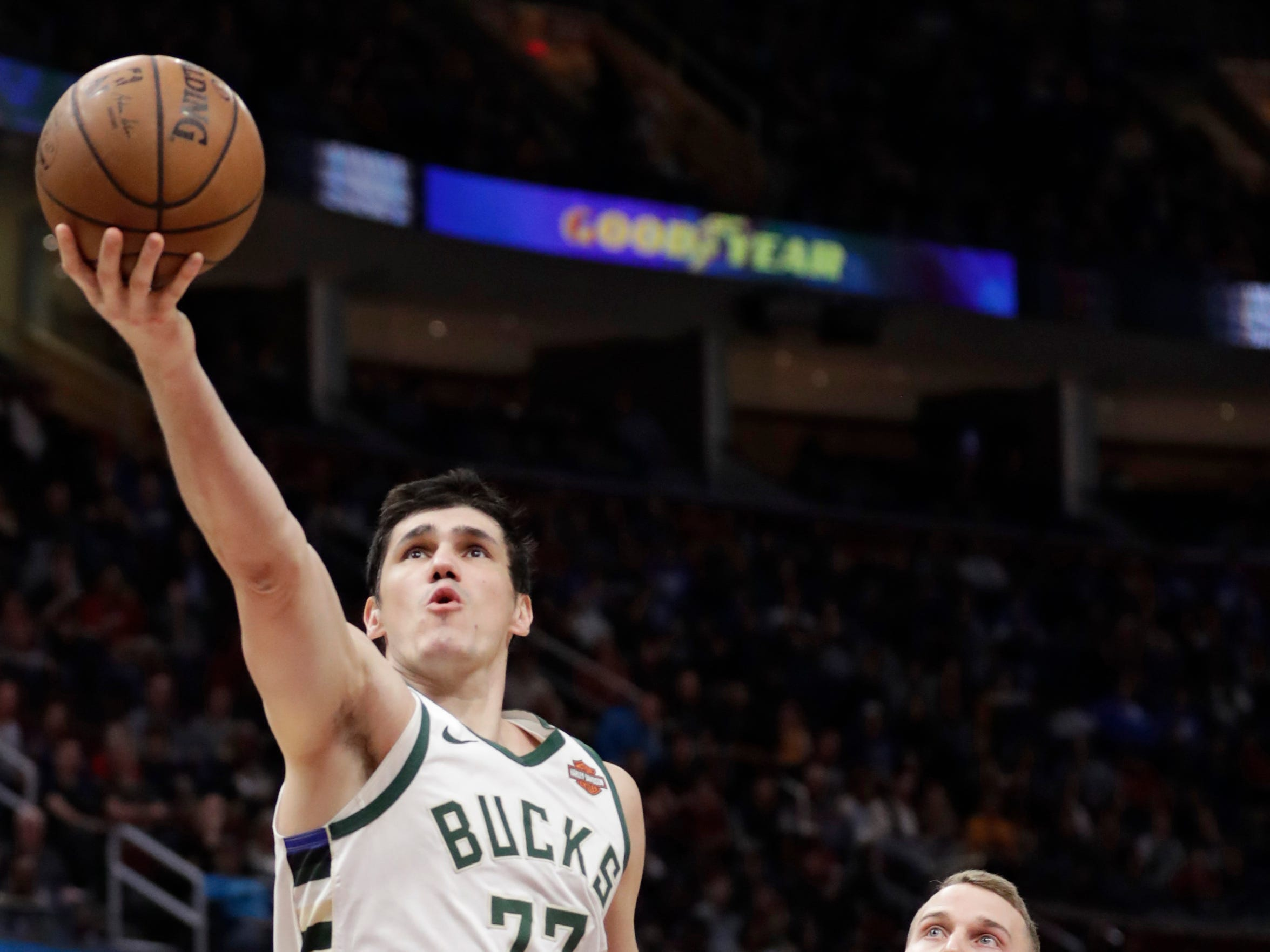 Bucks forward Ersan Ilyasova goes in for an underhanded layup in front of Nik Stauskas of the Cavaliers during the first half.
