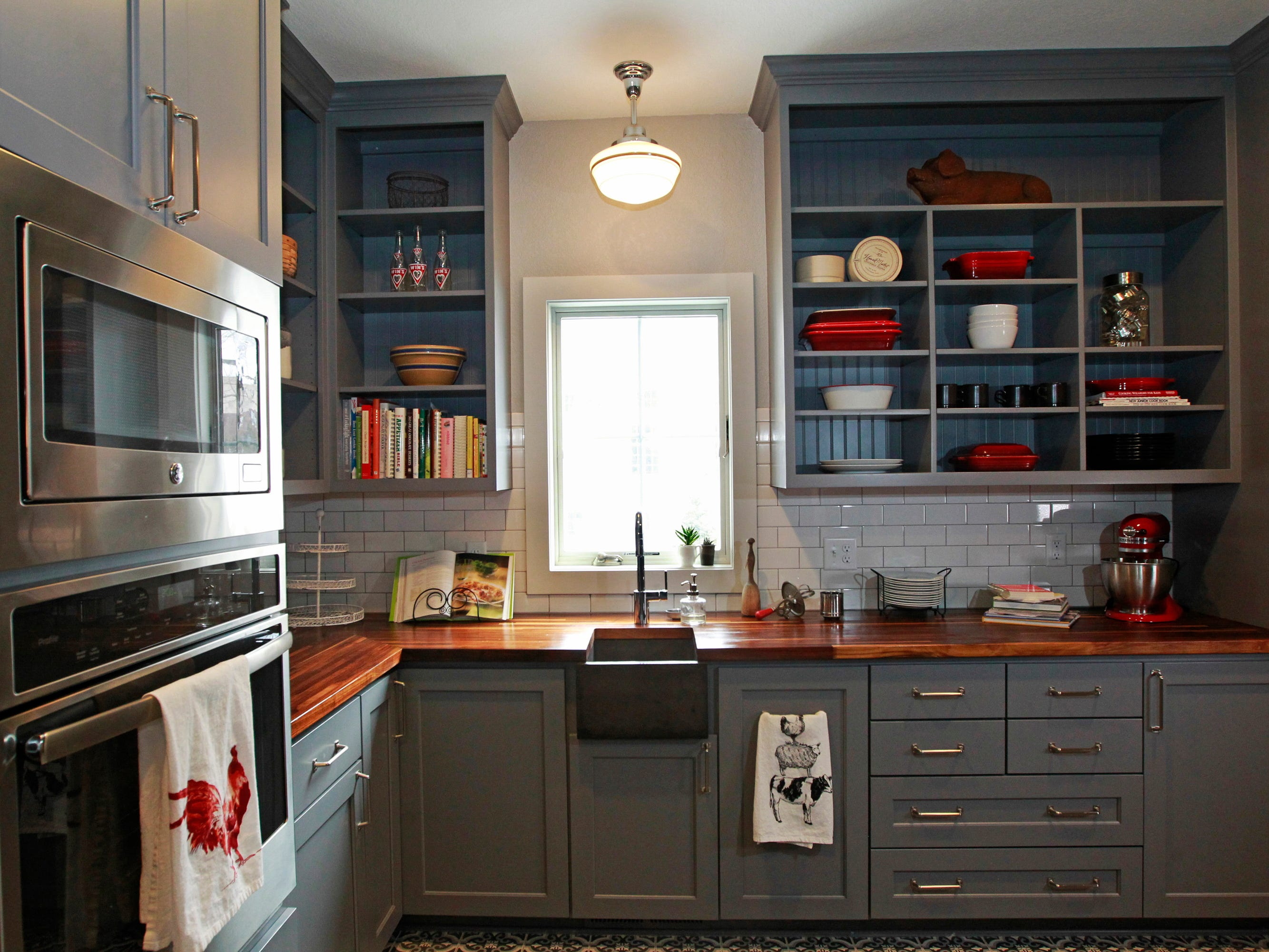The butler's pantry provides a prep area, second stove, a microwave and additional storage beyond what's in the kitchen.