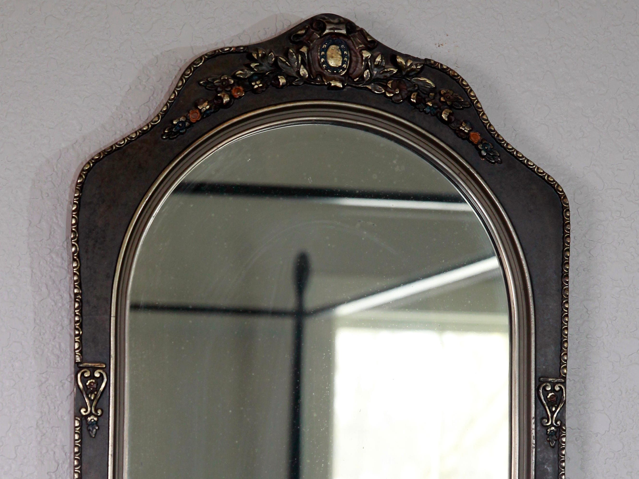 An antique mirror that belonged to Kurt Goranson's grandfather hangs in a guest bedroom.