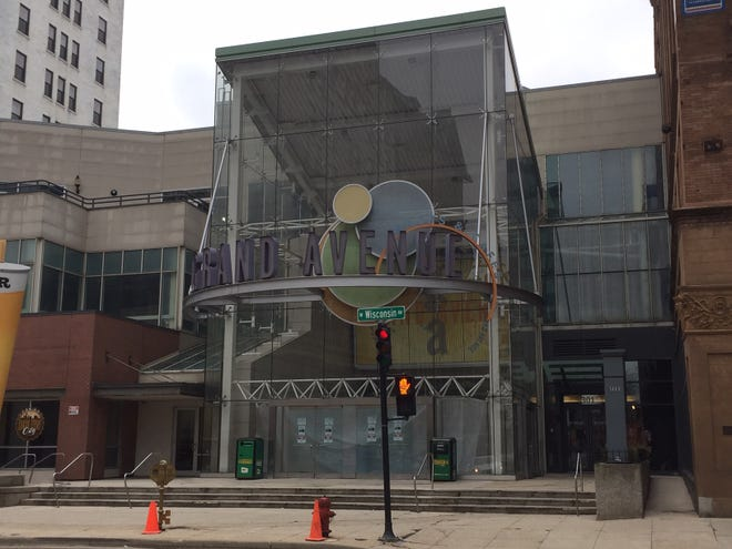 The former Grand Avenue's redevelopment includes replacing its main entrance with a public plaza.