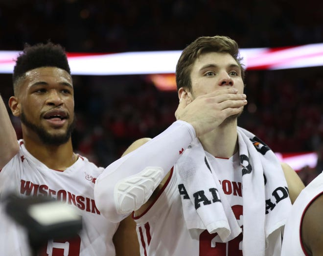Wisconsin forward Ethan Happ blows a kiss to the fans after his final home game.