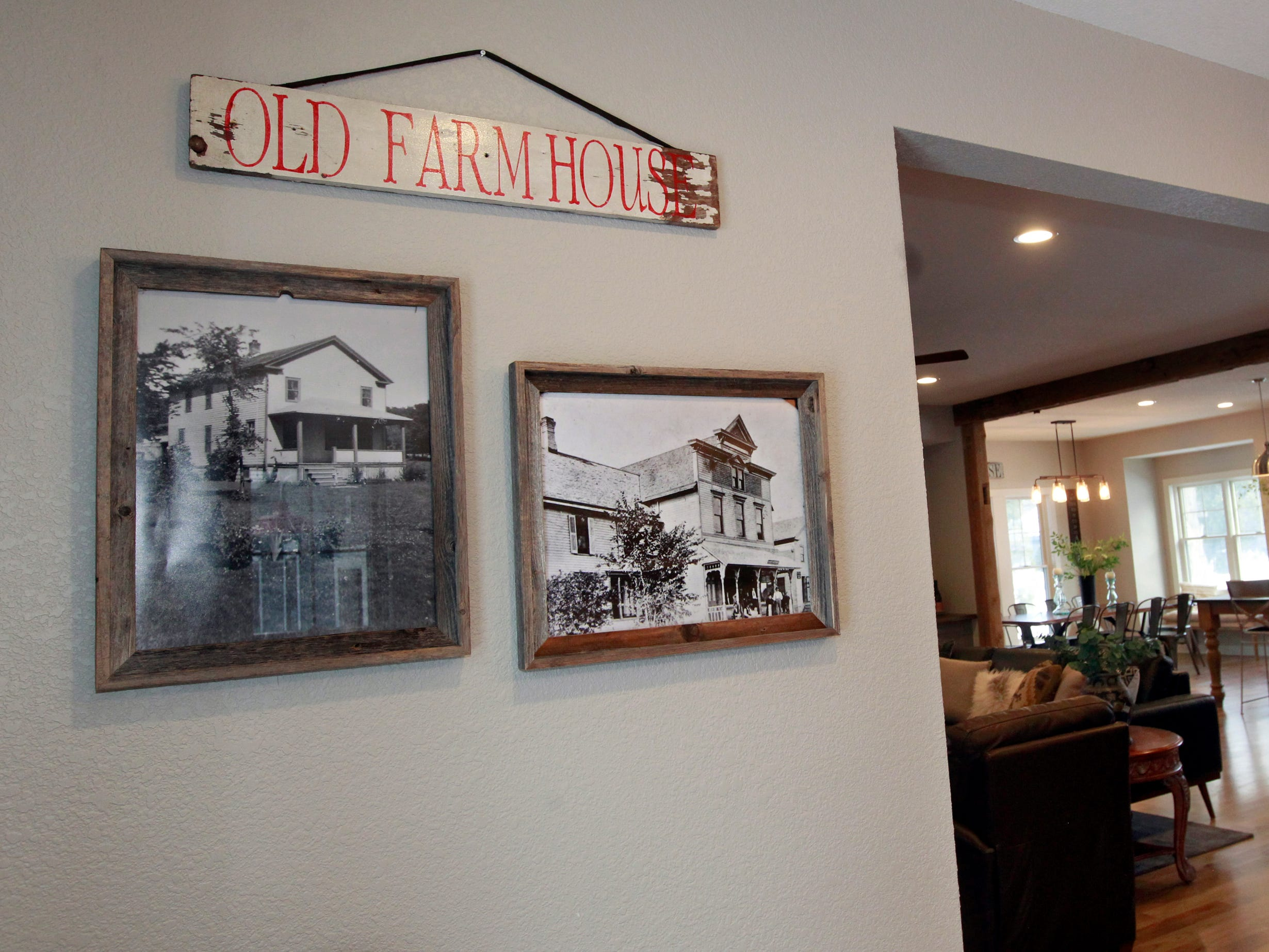 Historic photos are reminders of the farmhouse that was once on the property.