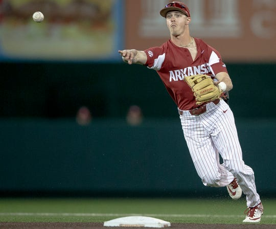Arkansas infielder Casey Martin throws to first for an out against Texas during a game earlier this year in Austin, Texas