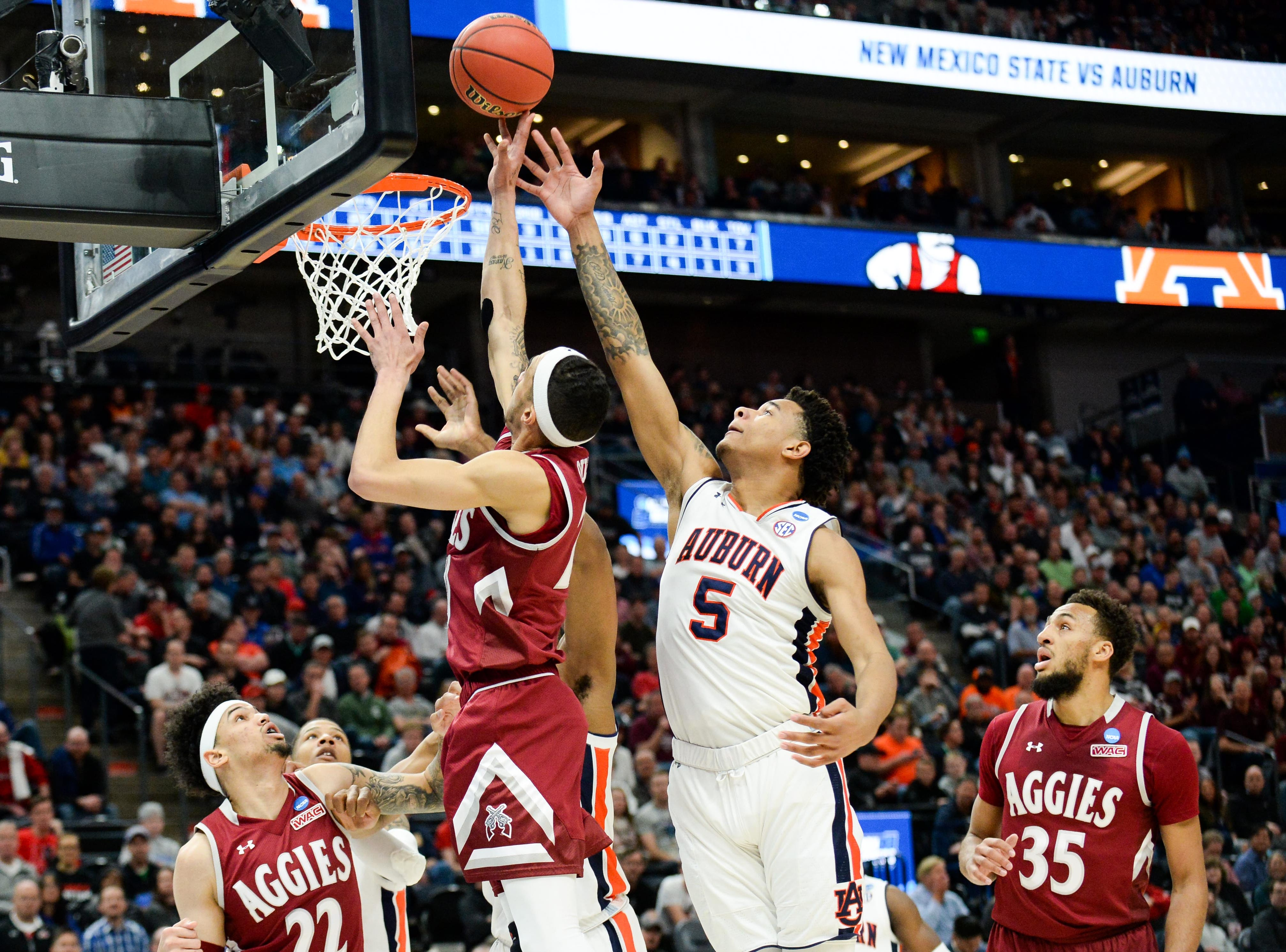 Mar 21, 2019; Salt Lake City, UT, USA; New Mexico State Aggies guard Trevelin Queen (20) goes for a shot ahead of Auburn Tigers forward Chuma Okeke (5) during the first half in the first round of the 2019 NCAA Tournament at Vivint Smart Home Arena. Mandatory Credit: Gary A. Vasquez-USA TODAY Sports