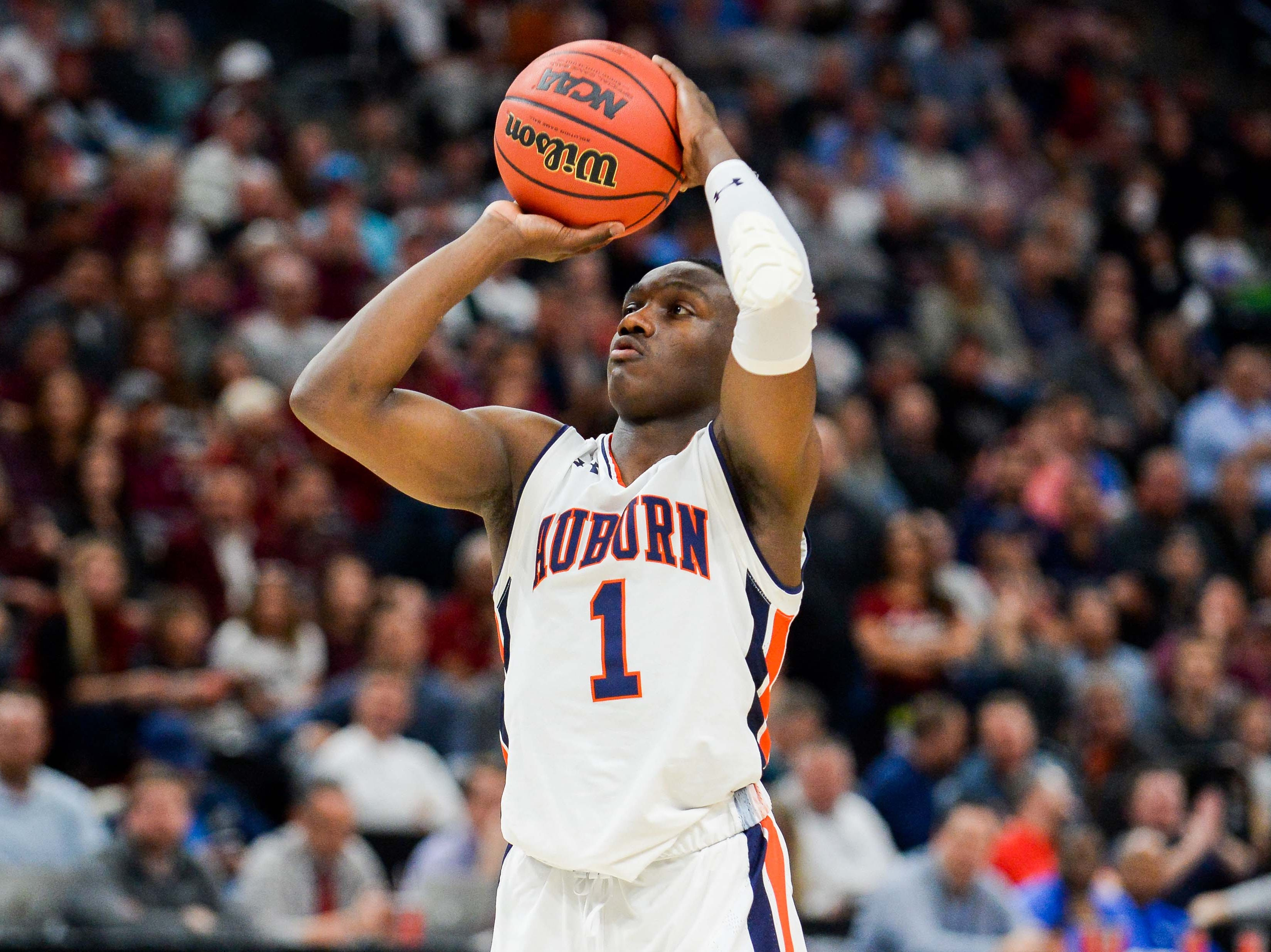 Mar 21, 2019; Salt Lake City, UT, USA; Auburn Tigers guard Jared Harper (1) at the free-throw line during the second half in the first round of the 2019 NCAA Tournament against the New Mexico State Aggies at Vivint Smart Home Arena. Mandatory Credit: Gary A. Vasquez-USA TODAY Sports