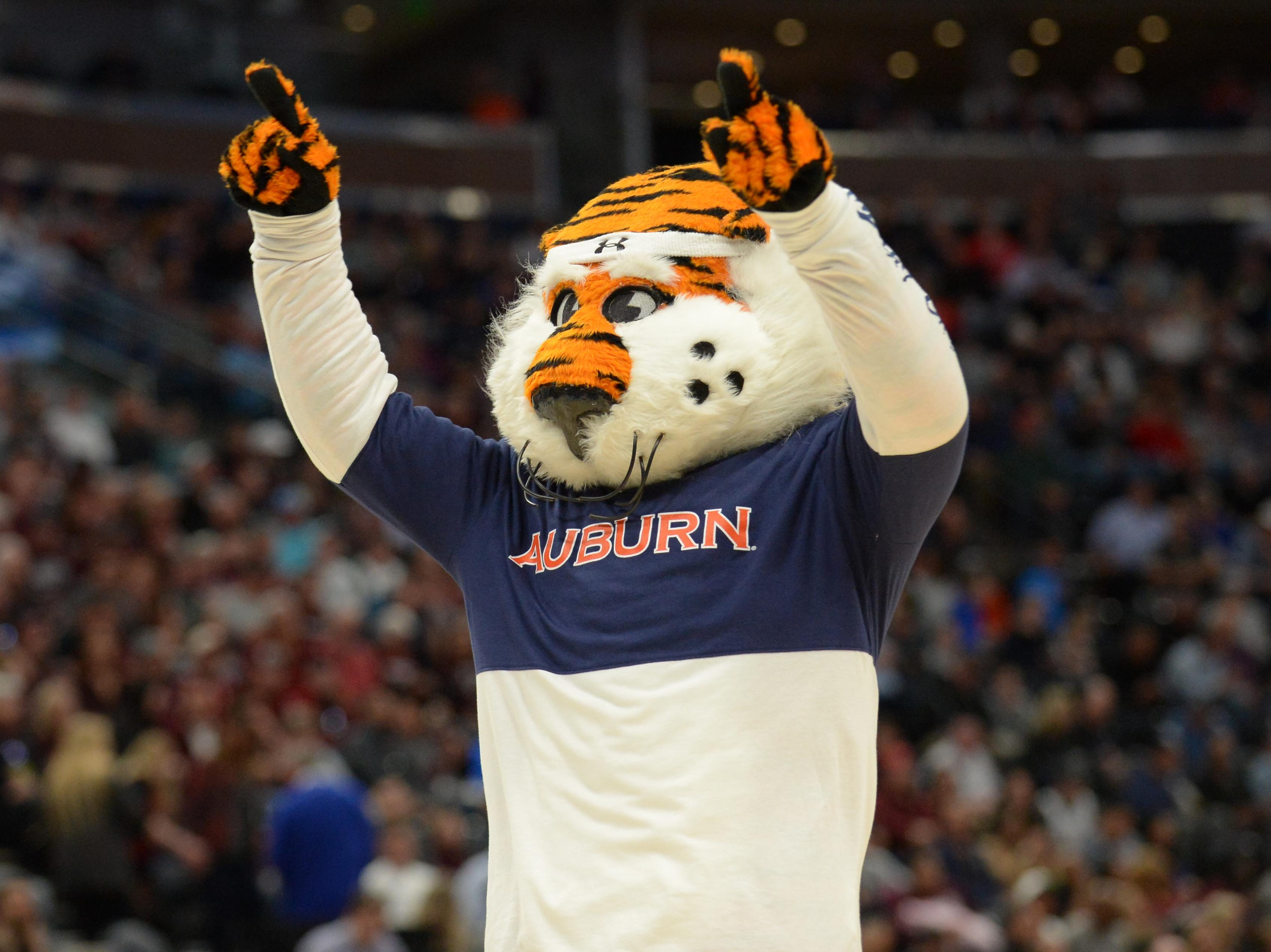 Mar 21, 2019; Salt Lake City, UT, USA; Auburn Tigers mascot Aubie performs during the first half in the first round of the 2019 NCAA Tournament against the New Mexico State Aggies at Vivint Smart Home Arena. Mandatory Credit: Gary A. Vasquez-USA TODAY Sports
