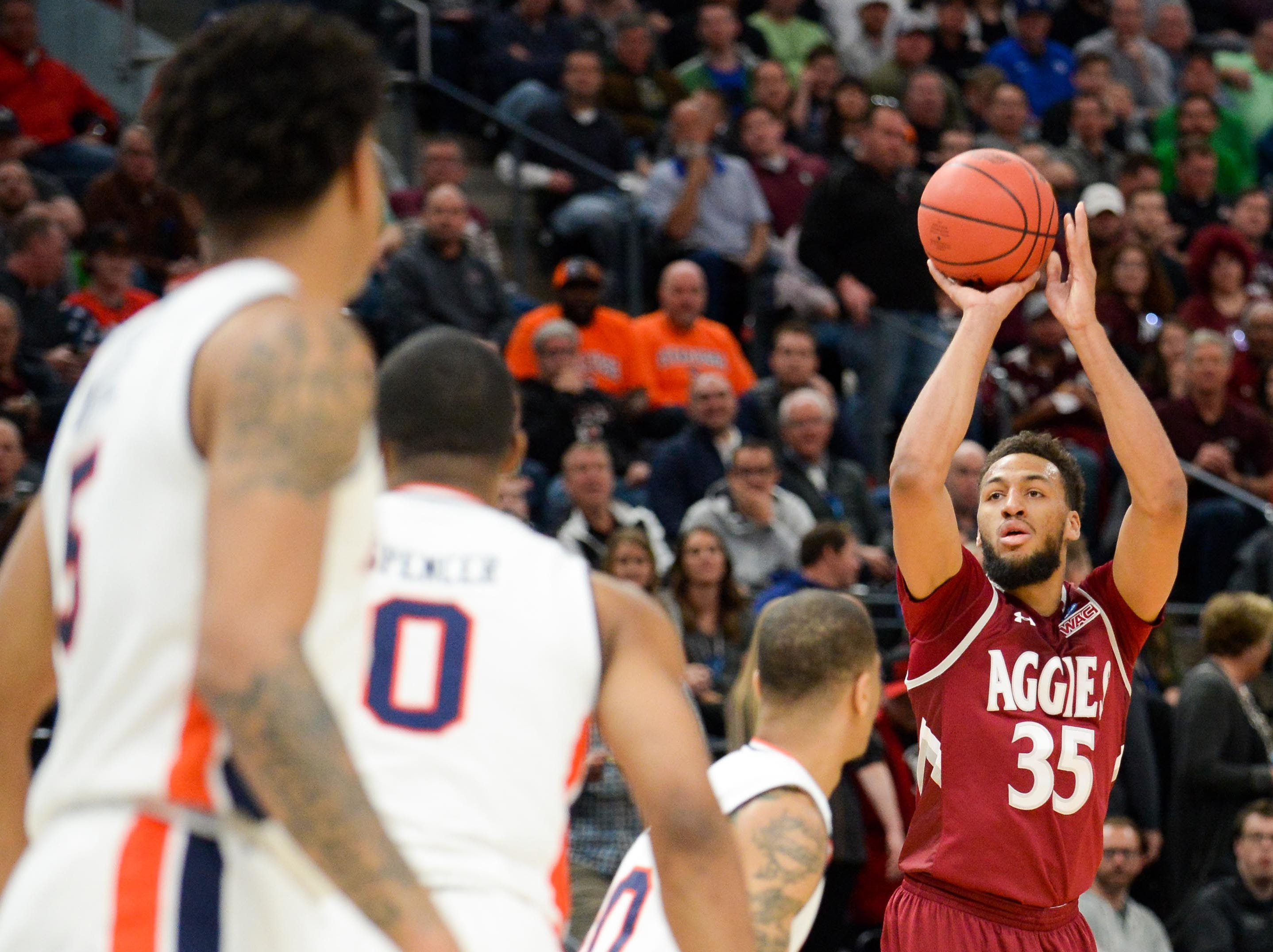 Mar 21, 2019; Salt Lake City, UT, USA; New Mexico State Aggies forward Johnny McCants (35) shoots over Auburn Tigers defense during the first half in the first round of the 2019 NCAA Tournament at Vivint Smart Home Arena. Mandatory Credit: Gary A. Vasquez-USA TODAY Sports