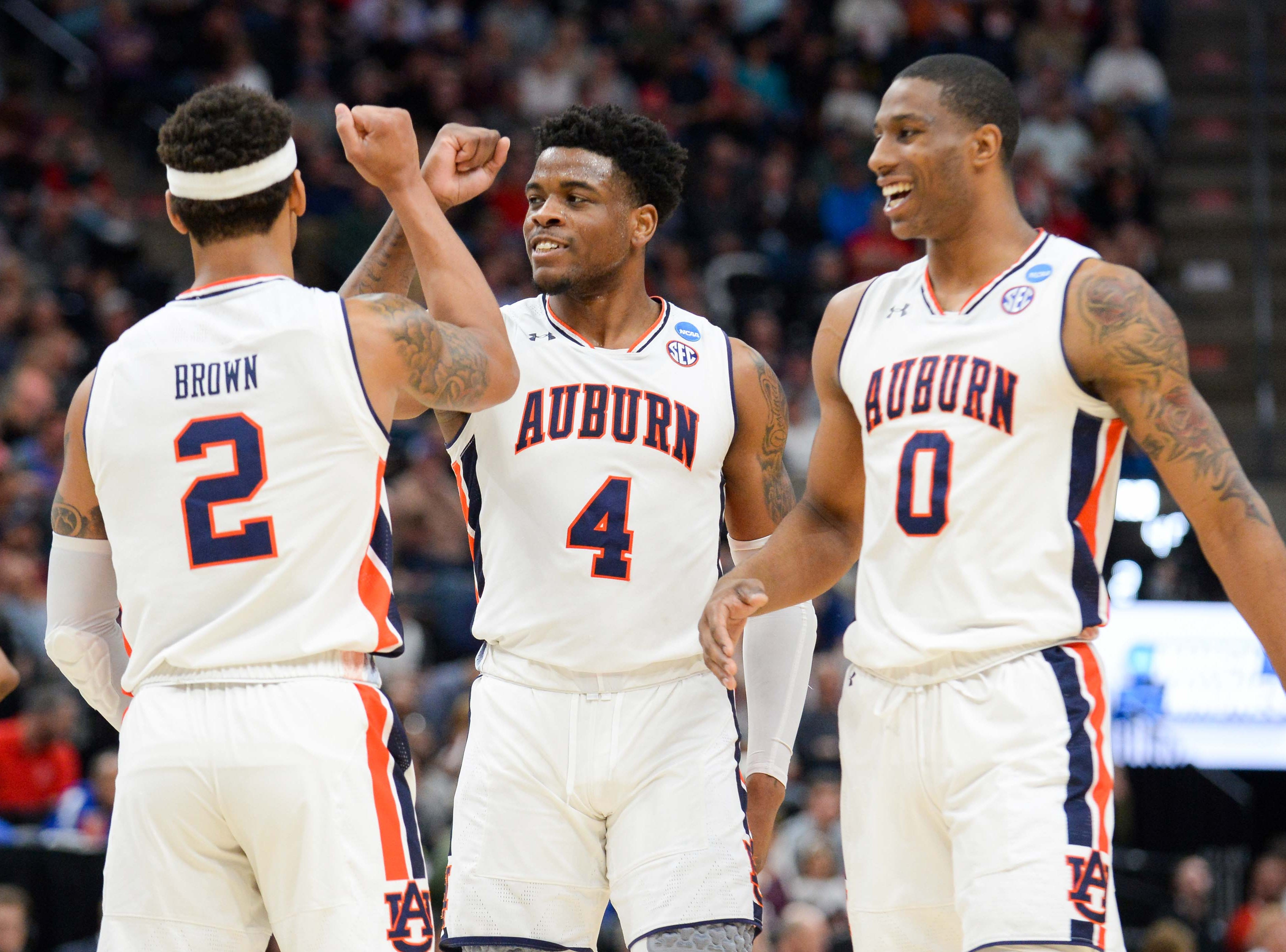 Mar 21, 2019; Salt Lake City, UT, USA; Auburn Tigers guard Bryce Brown (2) reacts with guard Malik Dunbar (4) and forward Horace Spencer (0) during the second half in the first round of the 2019 NCAA Tournament against the New Mexico State Aggies at Vivint Smart Home Arena. Mandatory Credit: Gary A. Vasquez-USA TODAY Sports