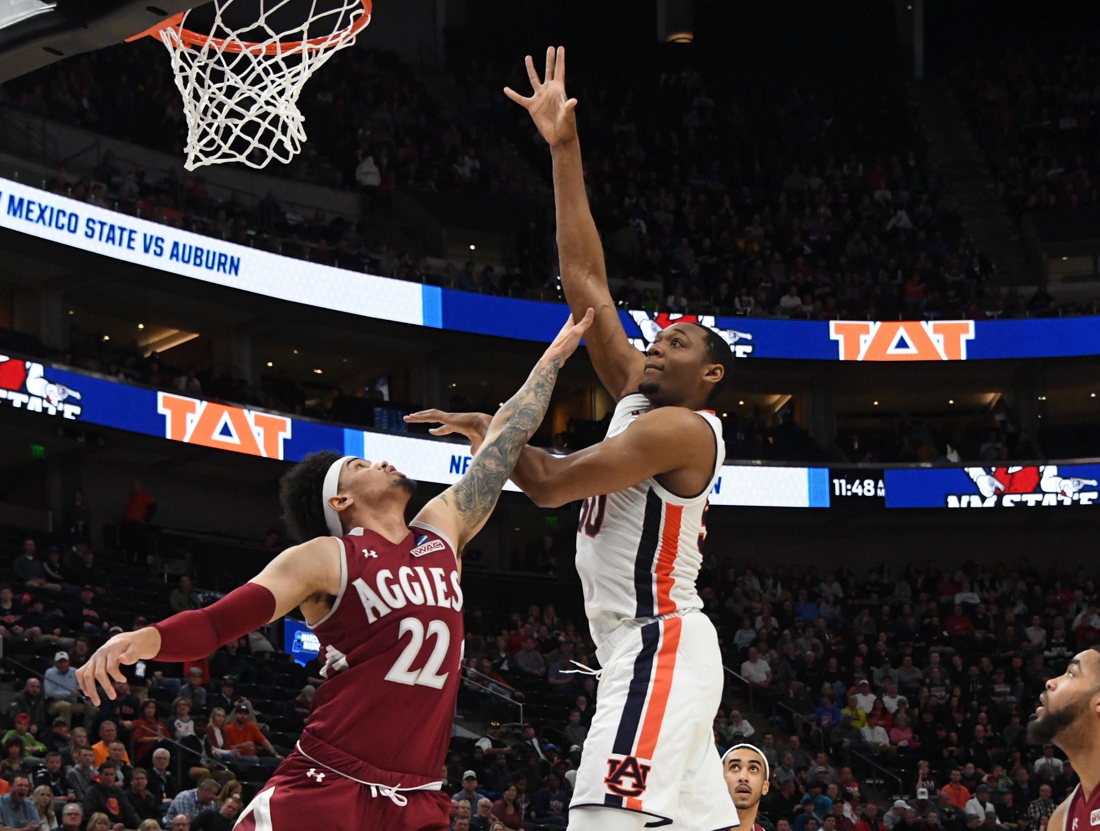 Mar 21, 2019; Salt Lake City, UT, USA; Auburn Tigers center Austin Wiley (50) shoots as New Mexico State Aggies forward Eli Chuha (22) defends during the first half in the first round of the 2019 NCAA Tournament at Vivint Smart Home Arena. Mandatory Credit: Kirby Lee-USA TODAY Sports