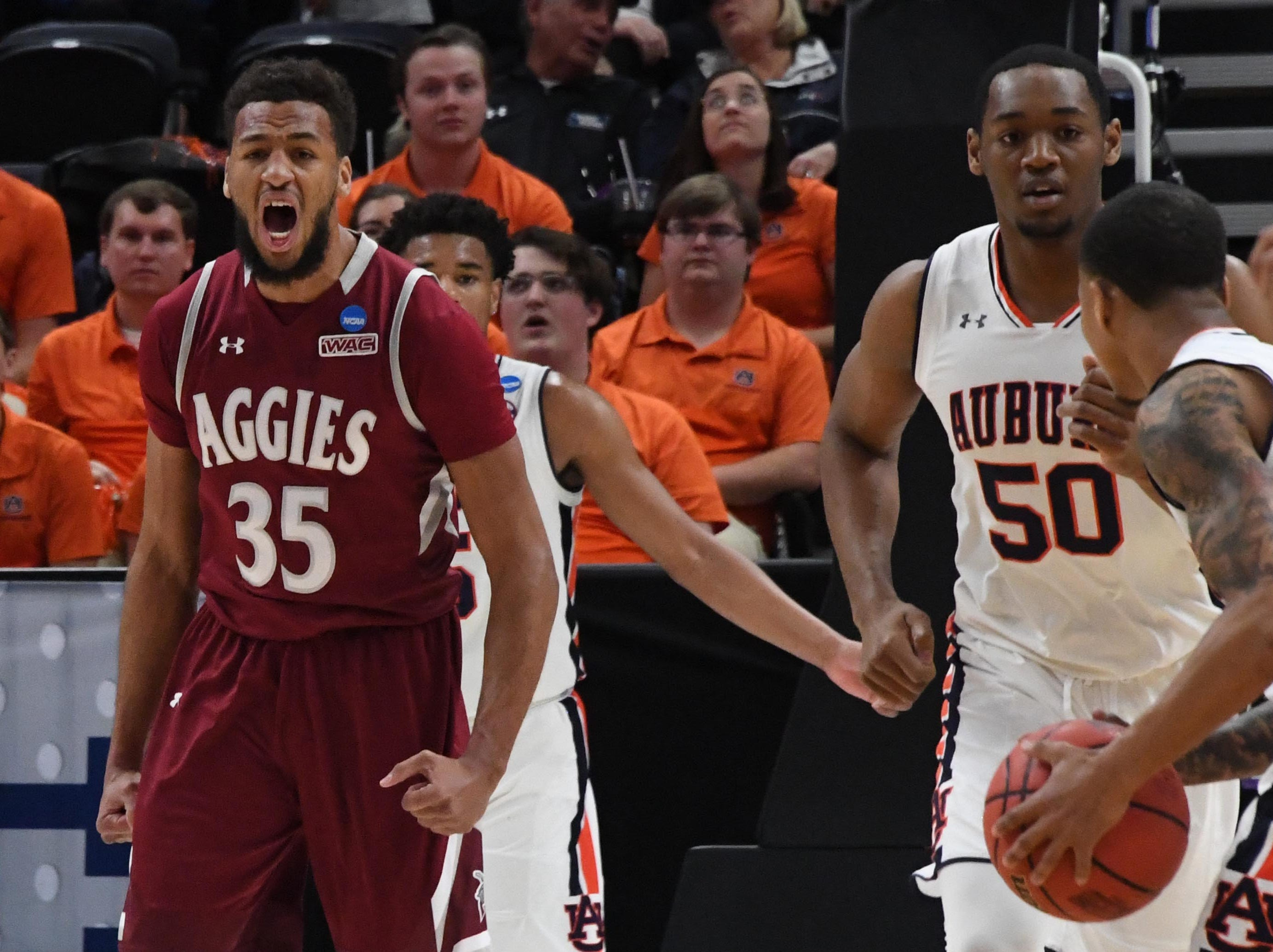 Mar 21, 2019; Salt Lake City, UT, USA; New Mexico State Aggies forward Johnny McCants (35) reacts during the first half in the first round of the 2019 NCAA Tournament against the Auburn Tigers at Vivint Smart Home Arena. Mandatory Credit: Kirby Lee-USA TODAY Sports