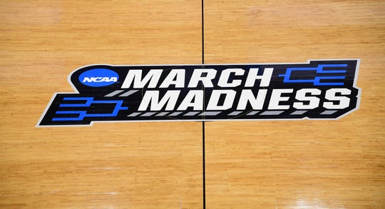 The March Madness logo at center court at Vivint Smart Home Arena in Salt Lake City.