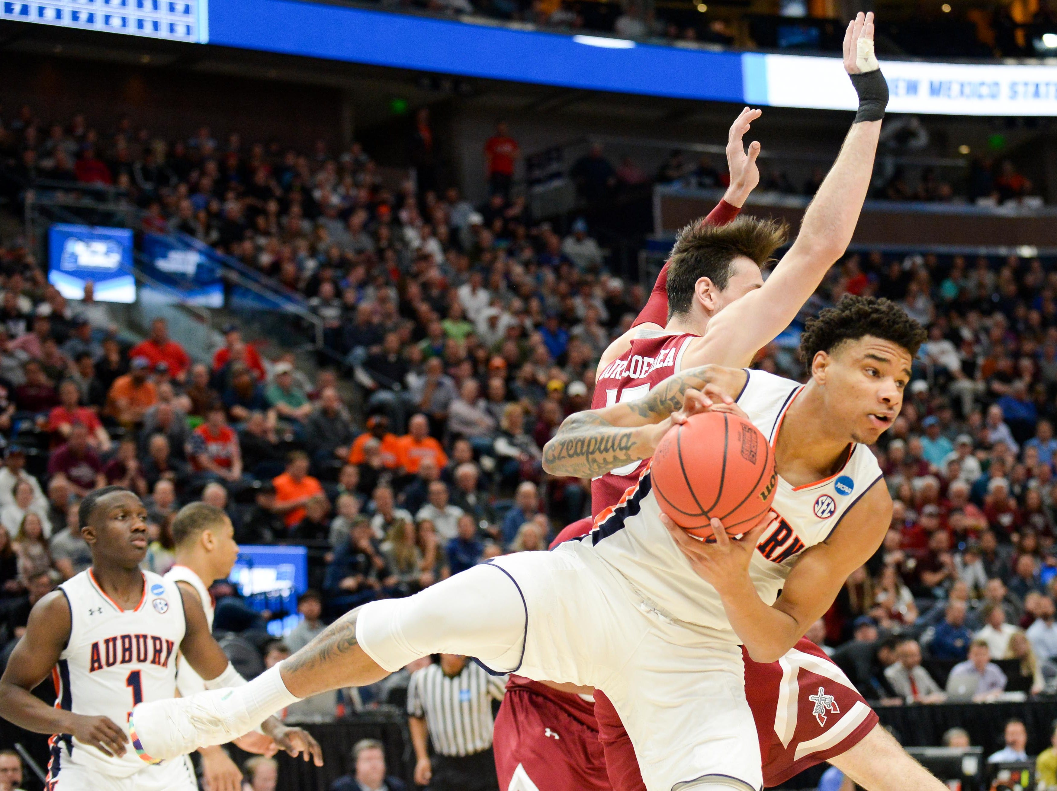 Mar 21, 2019; Salt Lake City, UT, USA; Auburn Tigers forward Chuma Okeke (5) brings down a rebound as New Mexico State Aggies forward Ivan Aurrecoechea (15) defends during the first half in the first round of the 2019 NCAA Tournament at Vivint Smart Home Arena. Mandatory Credit: Gary A. Vasquez-USA TODAY Sports