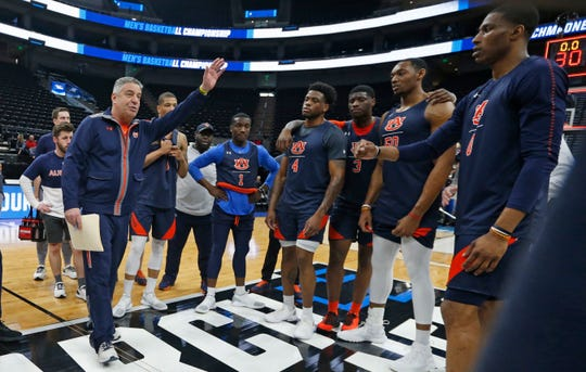 Auburn head coach Bruce Pearl speaks with his team during practice at the NCAA Tournament on Wednesday, March 20, 2019, in Salt Lake City.