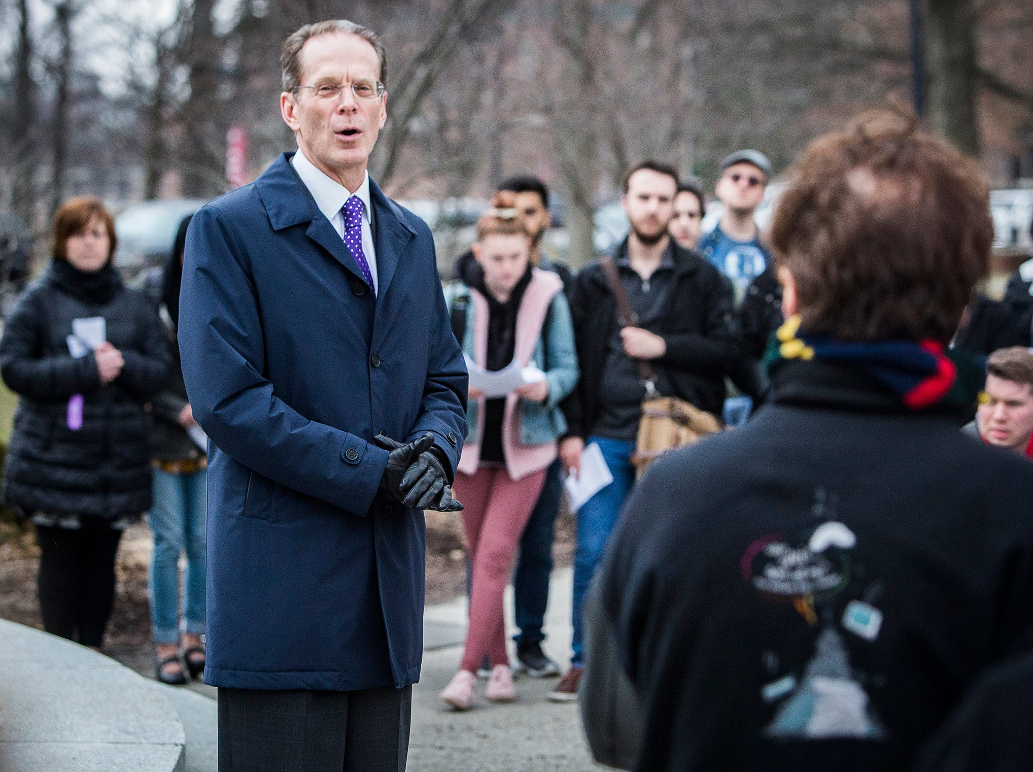Ball State president Geoffrey Mearns speaks to attendees of a vigil for the victims of the Christchurch, New Zealand mosque shootings near the university's Beneficence statue Thursday afternoon.