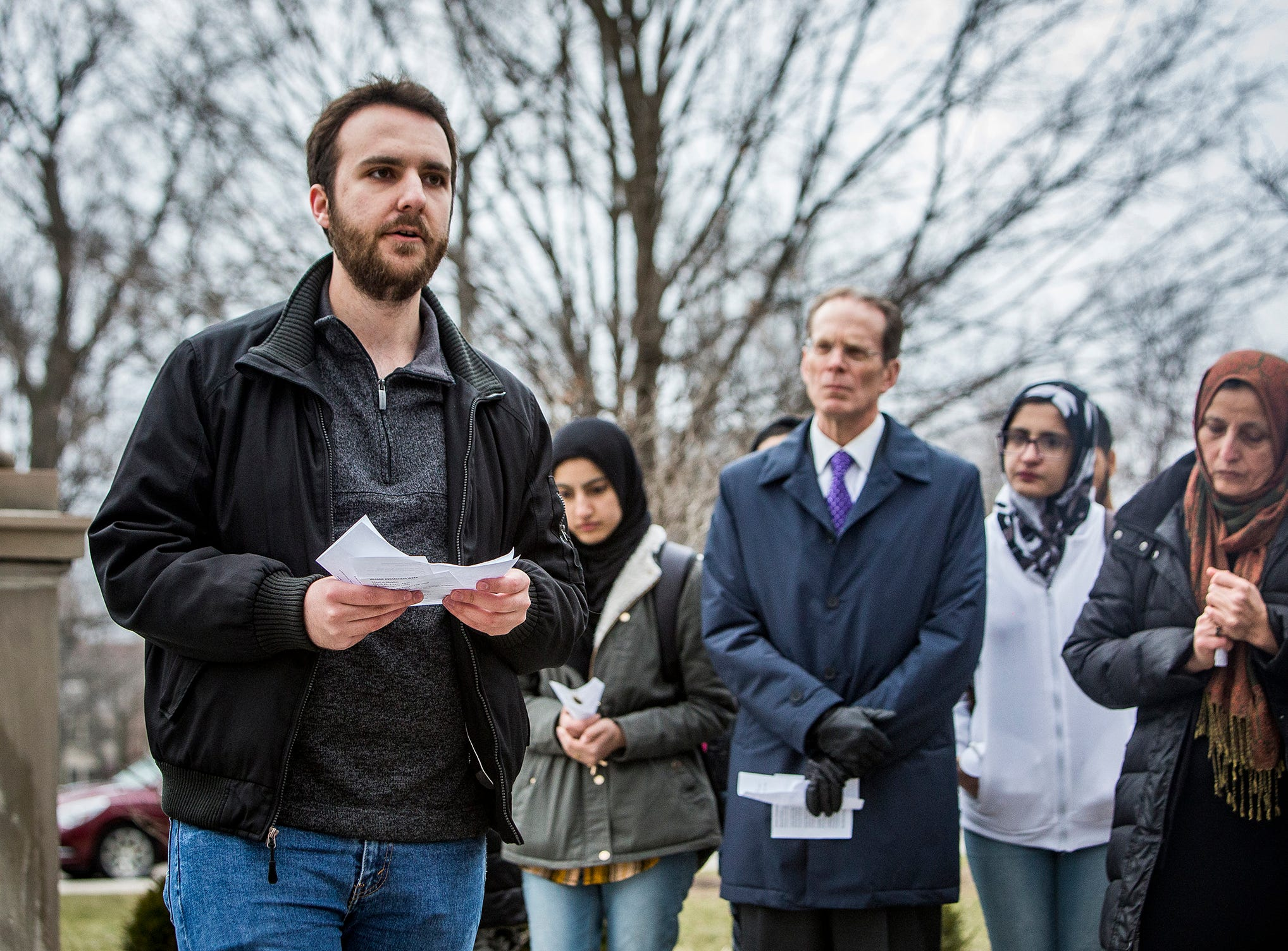 Mendim Akiti of Ball State's Muslim Student Association speaks during a vigil for the Christchurch, New Zealand shooting victims in front of the university's Beneficence statue Thursday afternoon.