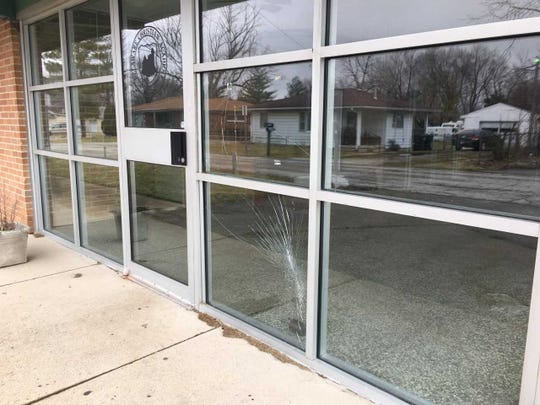 Windows are cracked at the main entrance to the former Riley school.
