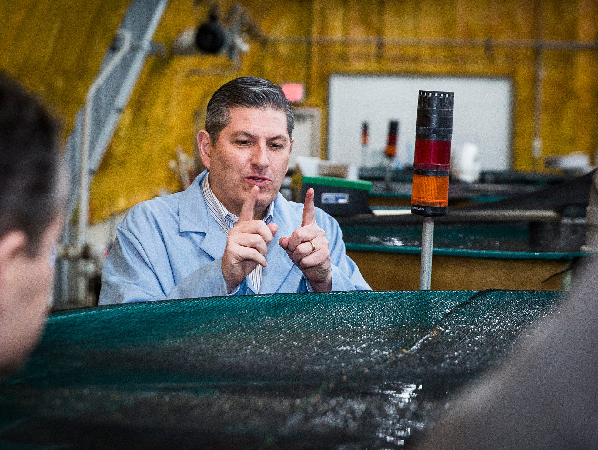 Intrexon official Bradley Shurdut speaks during a tour of the AquaBounty salmon farm.