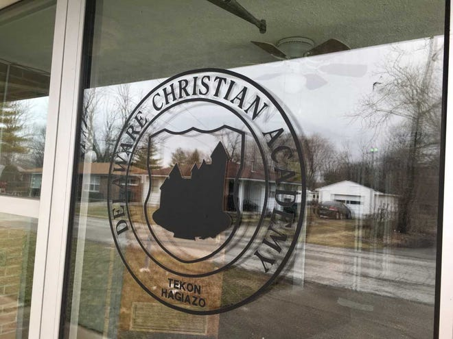 A sign on the front door advertises the Delaware Christian Academy.