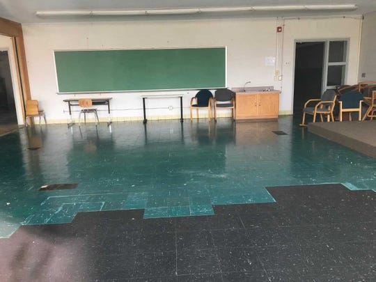 An empty classroom still contains chairs and desks at the former Riley school.