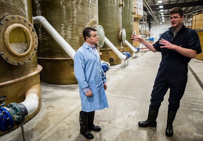 Sen. Todd Young talks to AquaBounty's Peter Bowyer during a tour.
