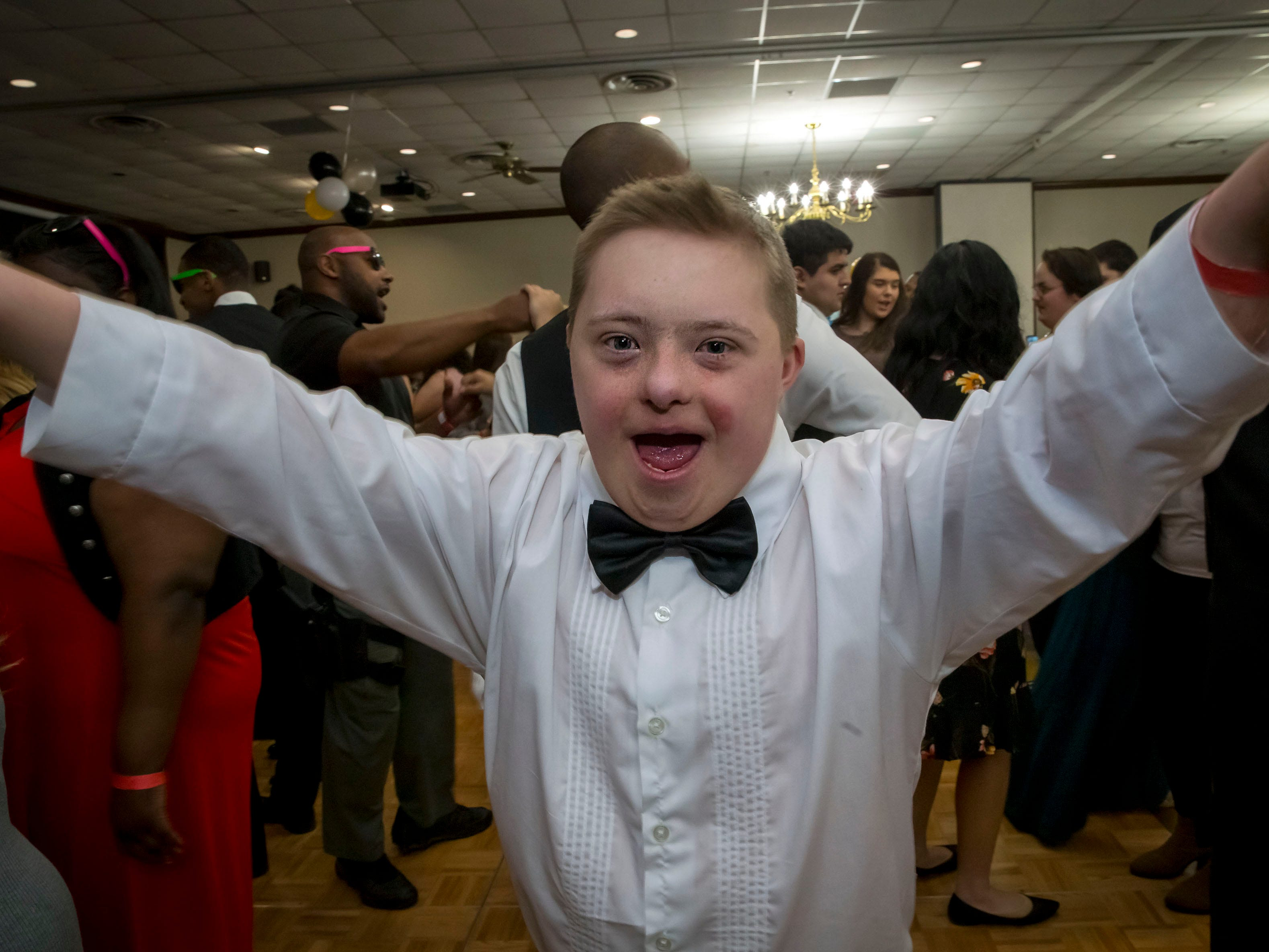 John Mangold dances at the Rutherford County Schools special needs prom held at Smyrna Event Center.