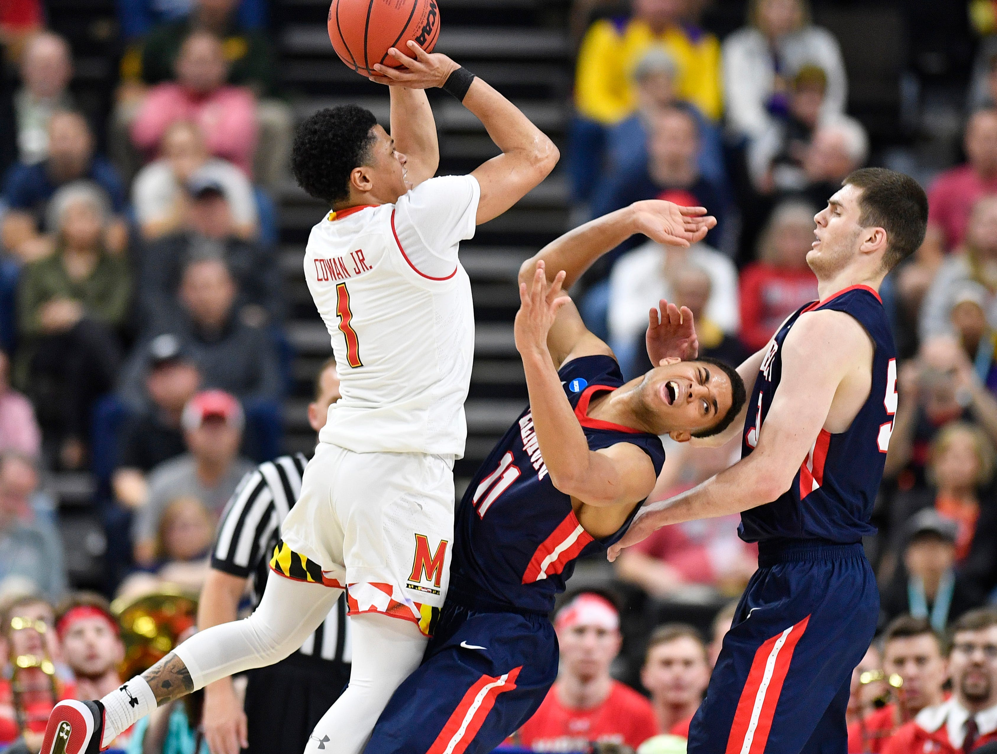 Maryland guard Anthony Cowan Jr. (1) shoots over Belmont guard Kevin McClain (11) during the second half of the first-round NCAA college basketball tournament game at VyStar Veterans Memorial Arena in Jacksonville, Fla., Thursday, March 21, 2019.