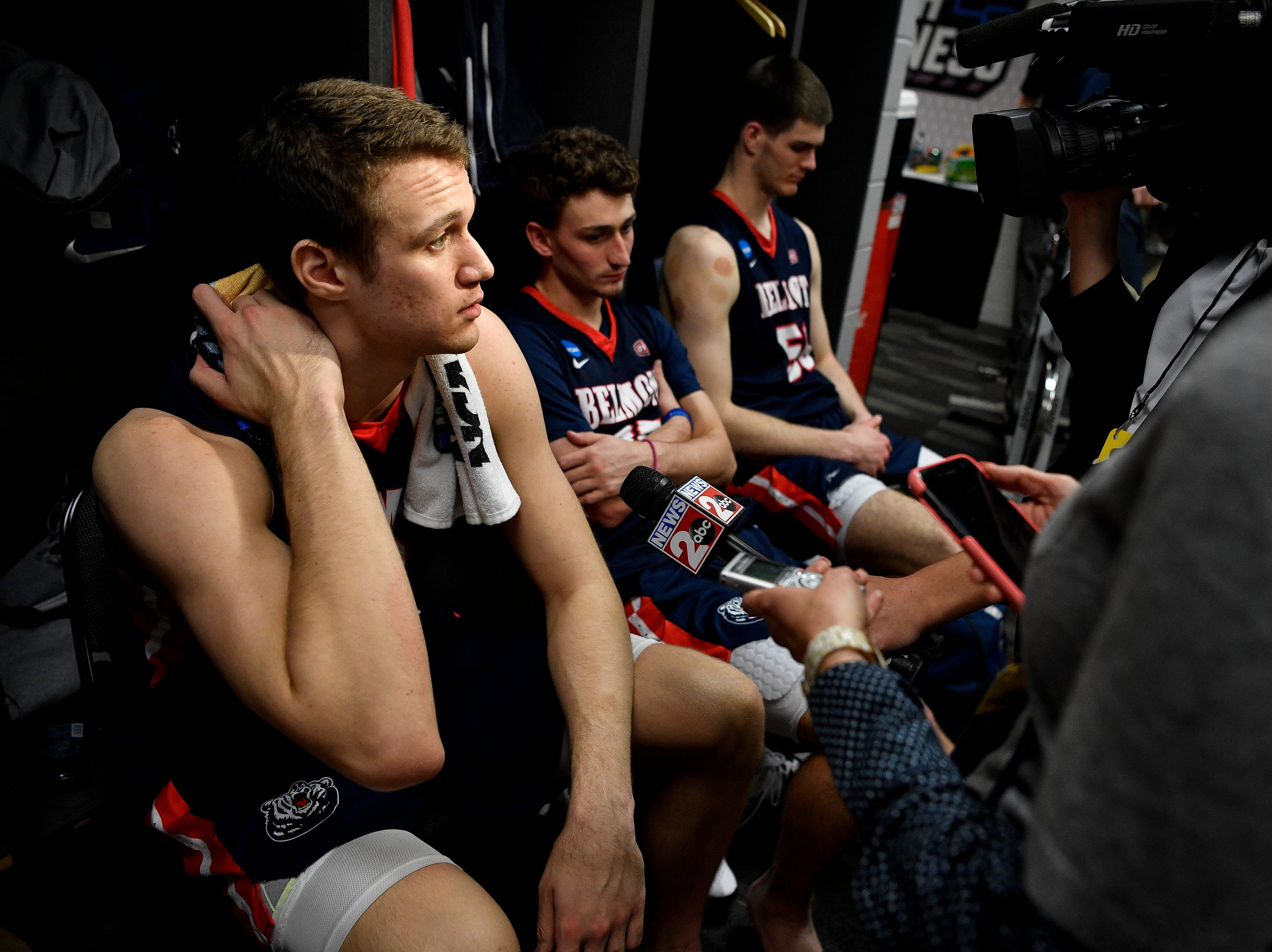 Belmont center Nick Muszynski (33) speaks to reporters in the locker room after their first-round NCAA college basketball tournament loss to Maryland at VyStar Veterans Memorial Arena in Jacksonville, Fla., Thursday, March 21, 2019.