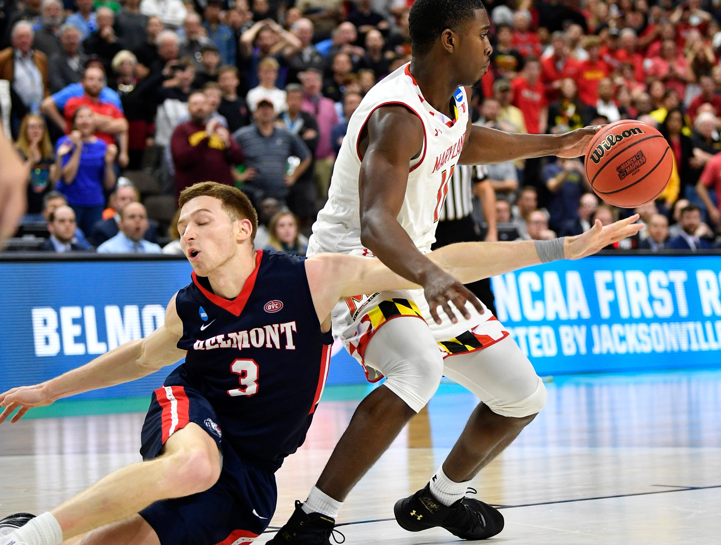 Belmont guard/forward Dylan Windler (3) battles Maryland guard Darryl Morsell (11) with seconds left in the second half of the first-round NCAA college basketball tournament game at VyStar Veterans Memorial Arena in Jacksonville, Fla., Thursday, March 21, 2019.