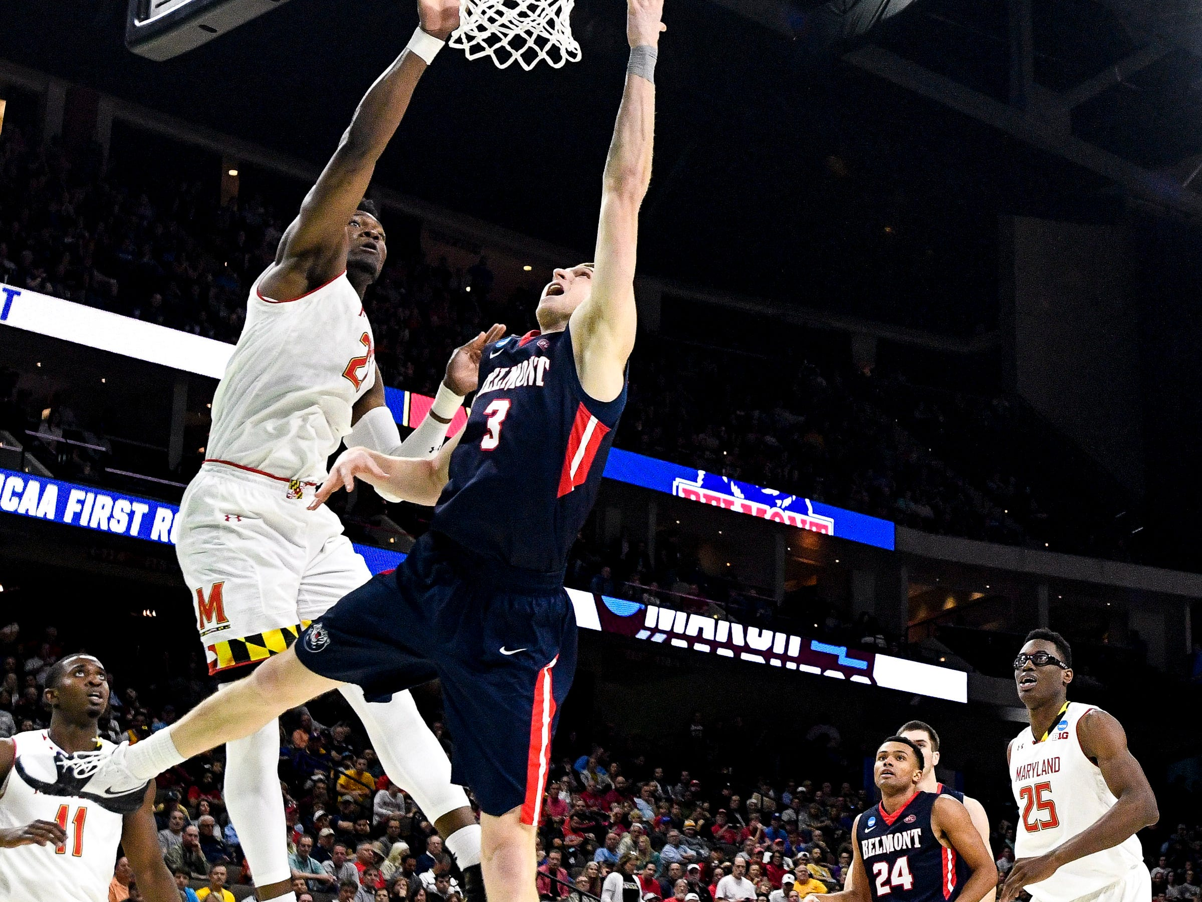 Belmont guard/forward Dylan Windler (3) shoots past Maryland forward Bruno Fernando (23) during the second half of the first-round NCAA college basketball tournament game at VyStar Veterans Memorial Arena in Jacksonville, Fla., Thursday, March 21, 2019.