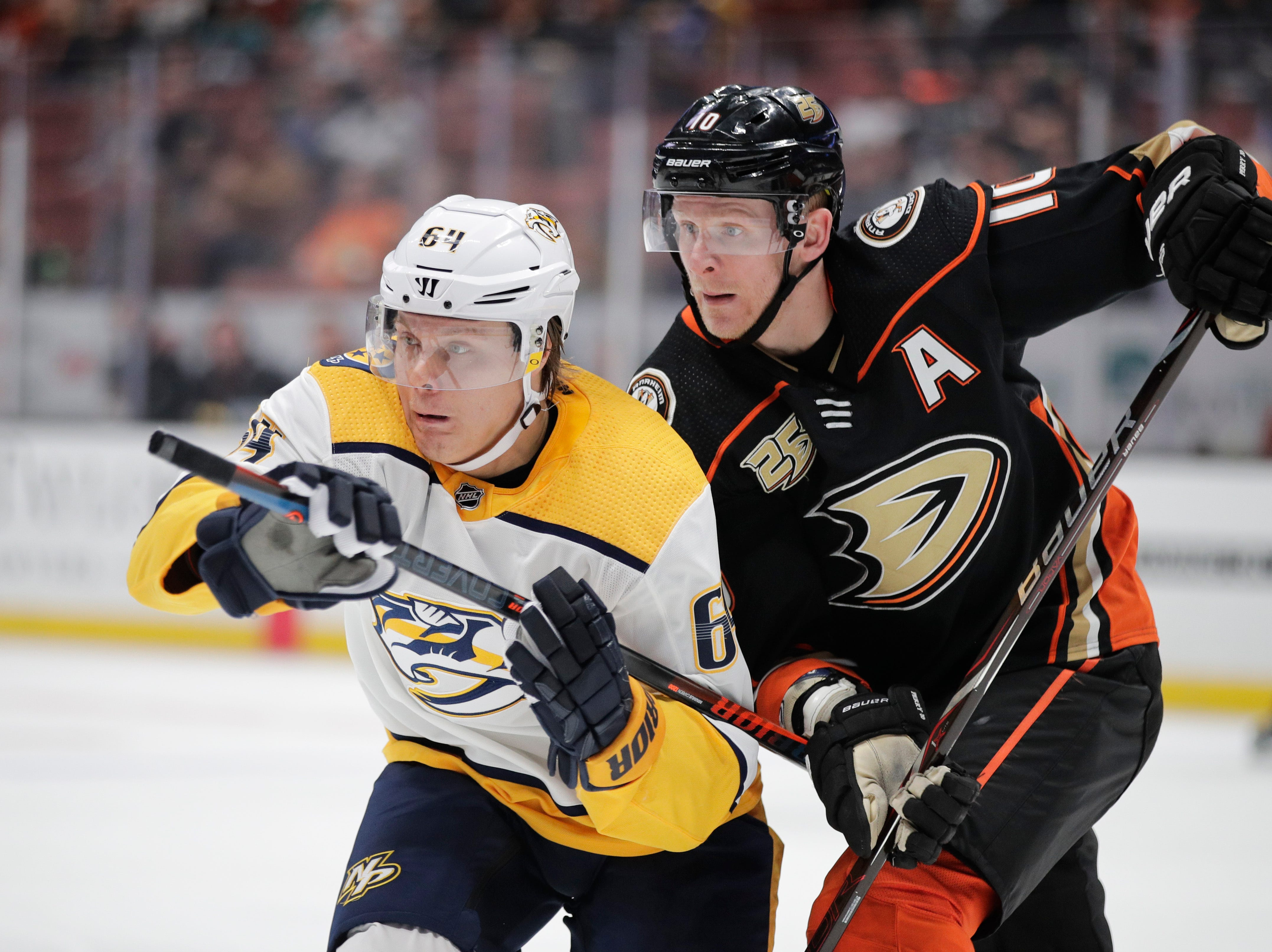 Nashville Predators' Mikael Granlund, left, and Anaheim Ducks' Corey Perry chase the puck on March 12, 2019.