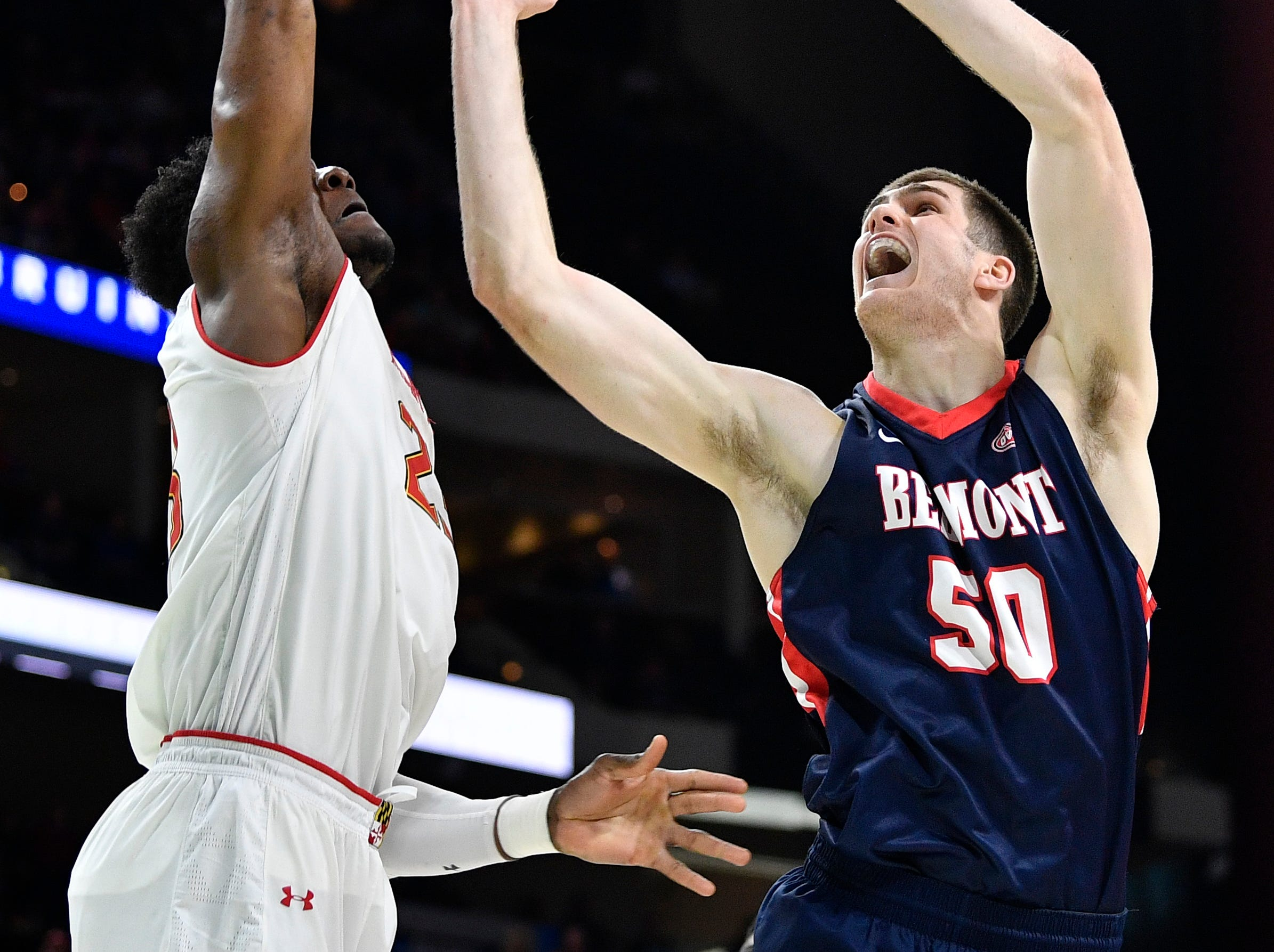 Maryland forward Bruno Fernando (23) blocks Belmont center Seth Adelsperger (50) during the second half of the first-round NCAA college basketball tournament game at VyStar Veterans Memorial Arena in Jacksonville, Fla., Thursday, March 21, 2019.
