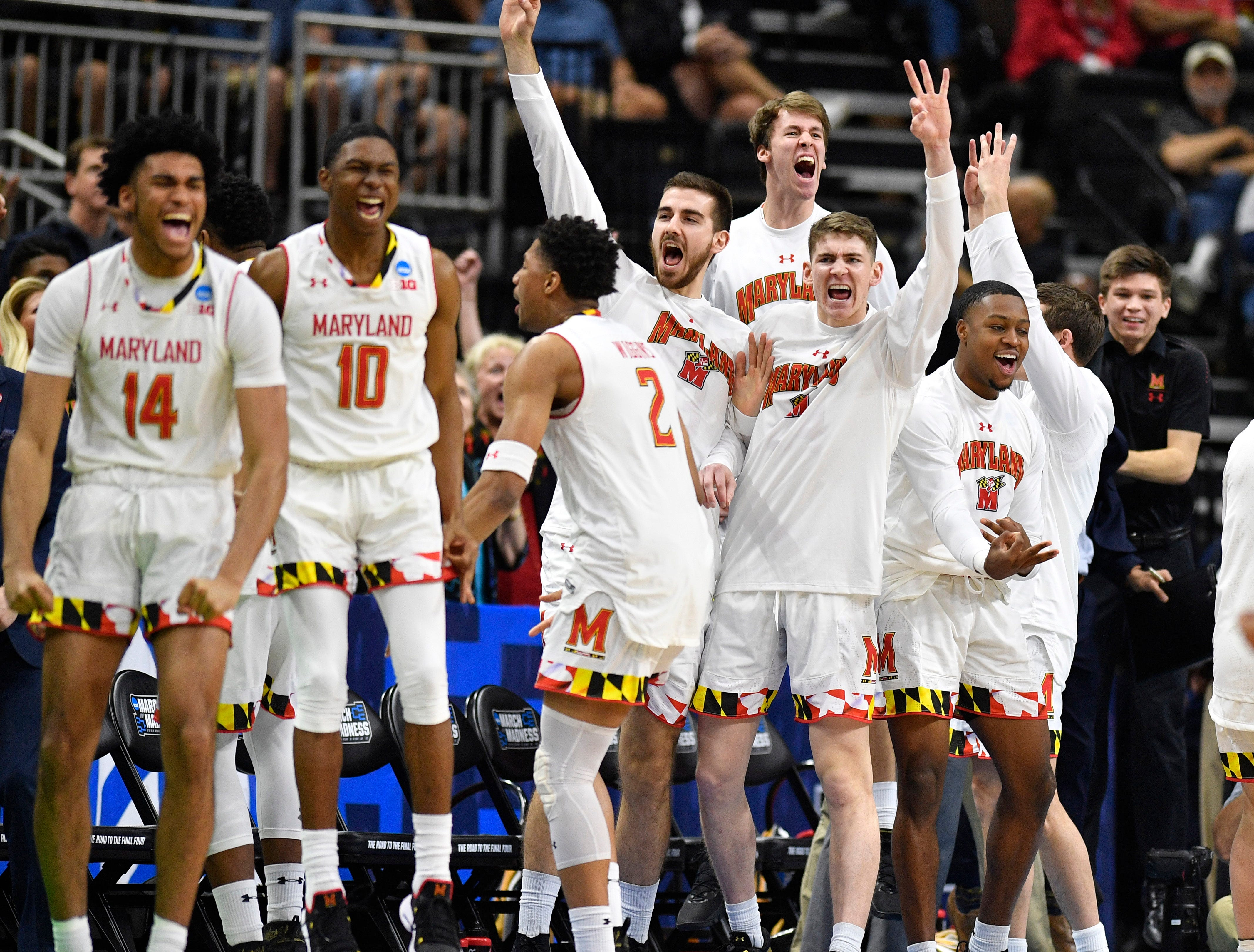 Maryland's bench reacts to a basket during the second half of the first-round NCAA college basketball tournament game against Belmont at VyStar Veterans Memorial Arena in Jacksonville, Fla., Thursday, March 21, 2019.